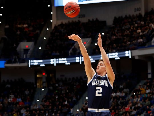 Villanova Wildcats guard Collin Gillespie (2) attempts a three point shot against the Purdue Boilermakers during the second half of a game in the second round of the 2019 NCAA Tournament at XL Center.