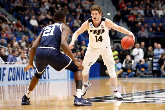 Mar 23, 2019; Hartford, CT, USA; Purdue Boilermakers guard Ryan Cline (14) dribbles the ball in front of Villanova Wildcats forward Dhamir Cosby-Roundtree (21) during the first half of a game in the second round of the 2019 NCAA Tournament at XL Center. Mandatory Credit: David Butler II-USA TODAY Sports