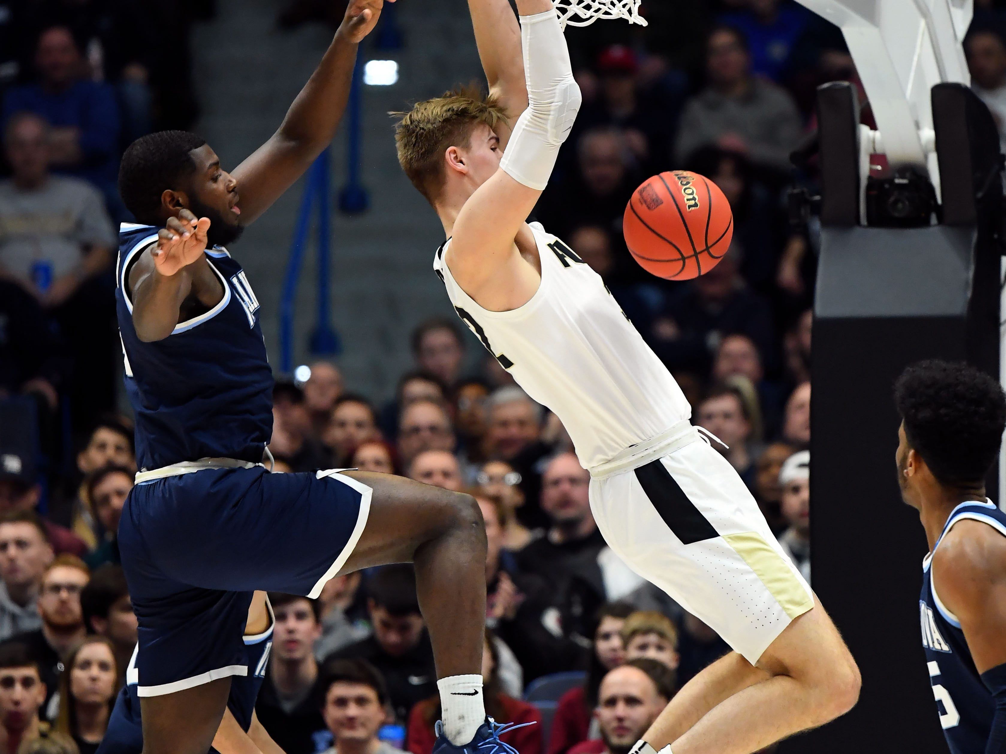 Mar 23, 2019; Hartford, CT, USA; Purdue Boilermakers center Matt Haarms (32) dunks and scores against the Villanova Wildcats during the first half of game in the second round of the 2019 NCAA Tournament at XL Center. Mandatory Credit: Robert Deutsch-USA TODAY Sports