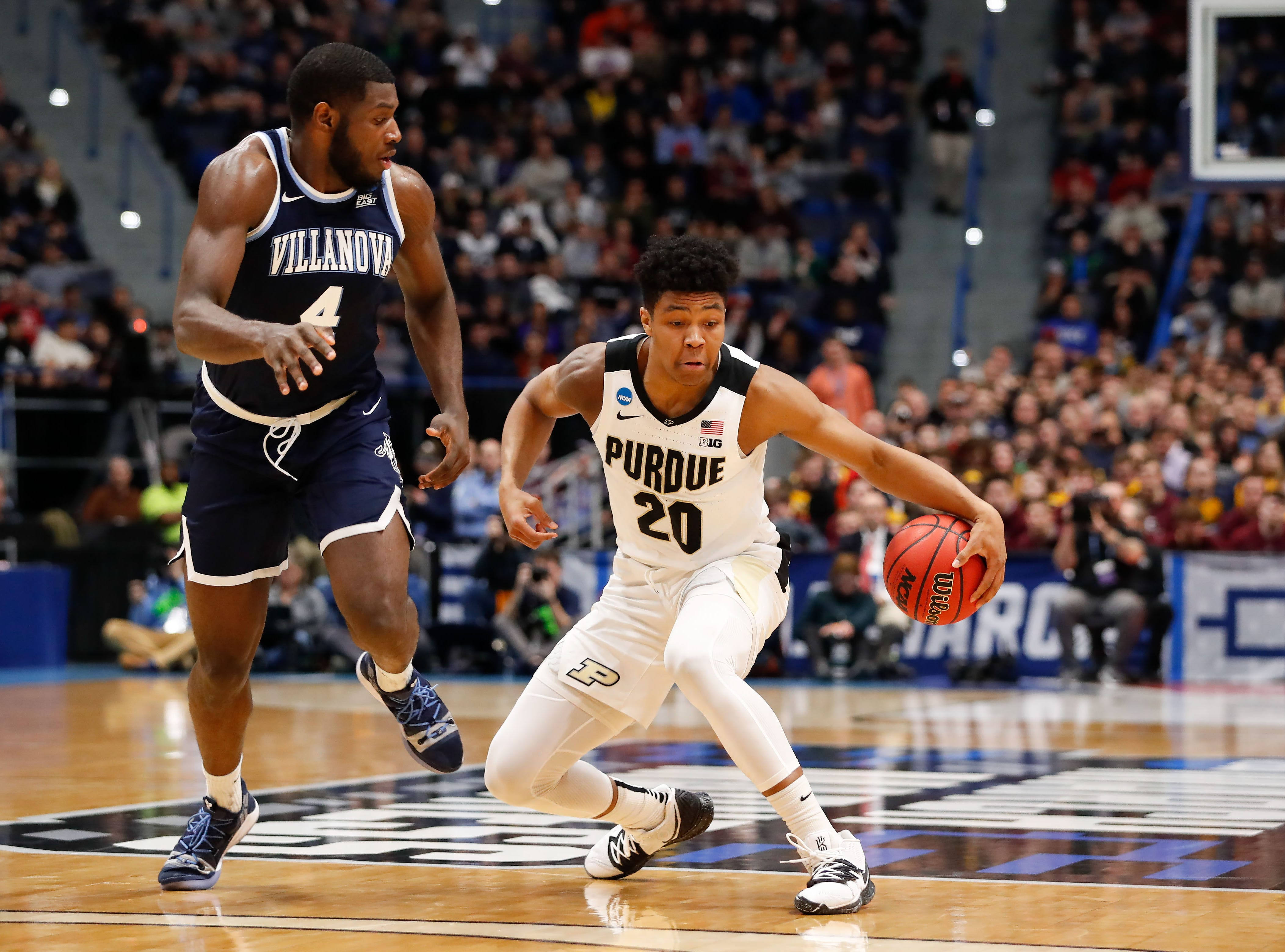 Mar 23, 2019; Hartford, CT, USA;Purdue Boilermakers guard Nojel Eastern (20) controls the ball in front of Villanova Wildcats forward Eric Paschall (4) during the first half of a game in the second round of the 2019 NCAA Tournament at XL Center. Mandatory Credit: David Butler II-USA TODAY Sports
