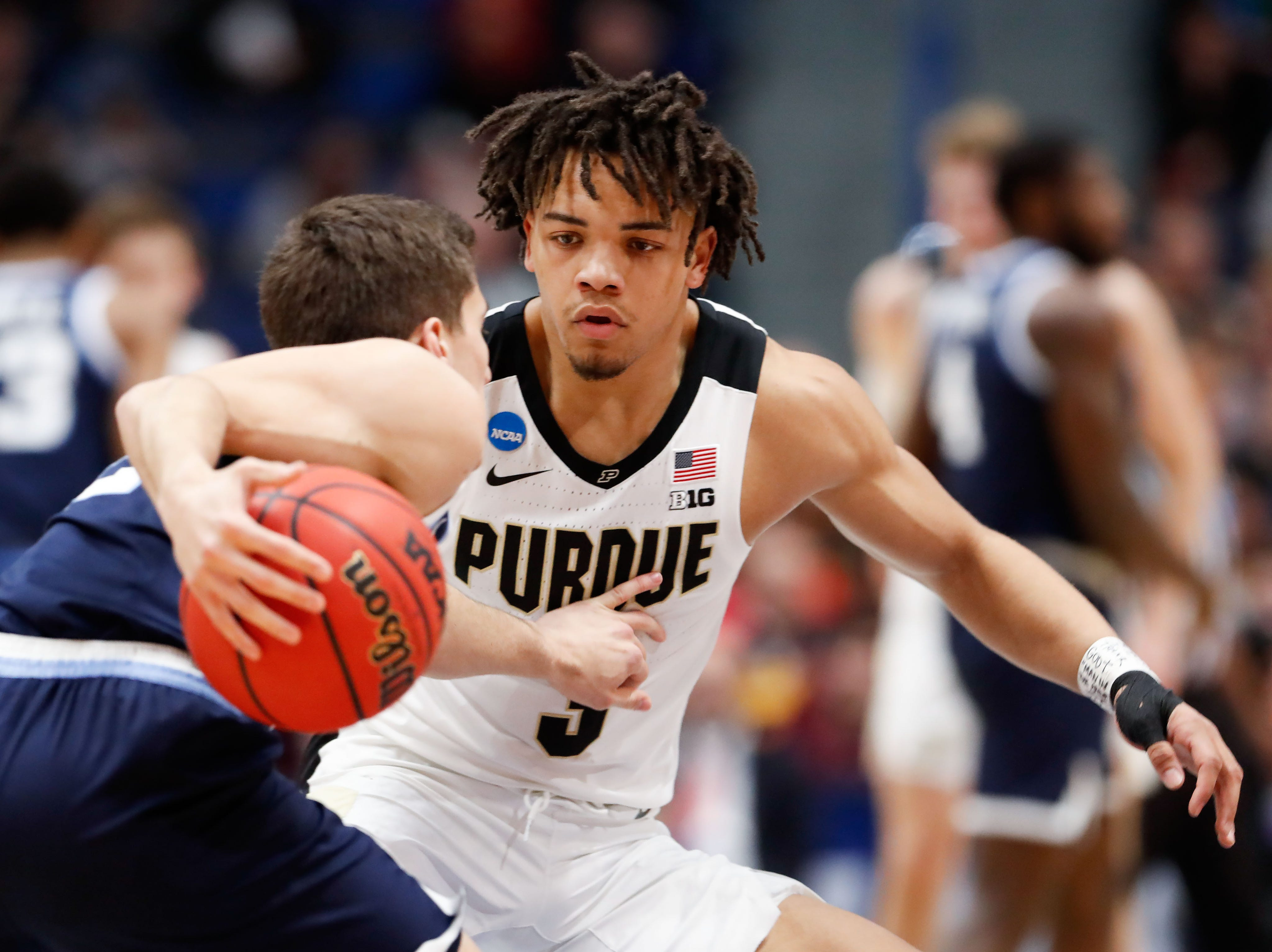 Mar 23, 2019; Hartford, CT, USA; Purdue Boilermakers guard Carsen Edwards (3) defends Villanova Wildcats guard Collin Gillespie (2) during the first half of a game in the second round of the 2019 NCAA Tournament at XL Center. Mandatory Credit: David Butler II-USA TODAY Sports