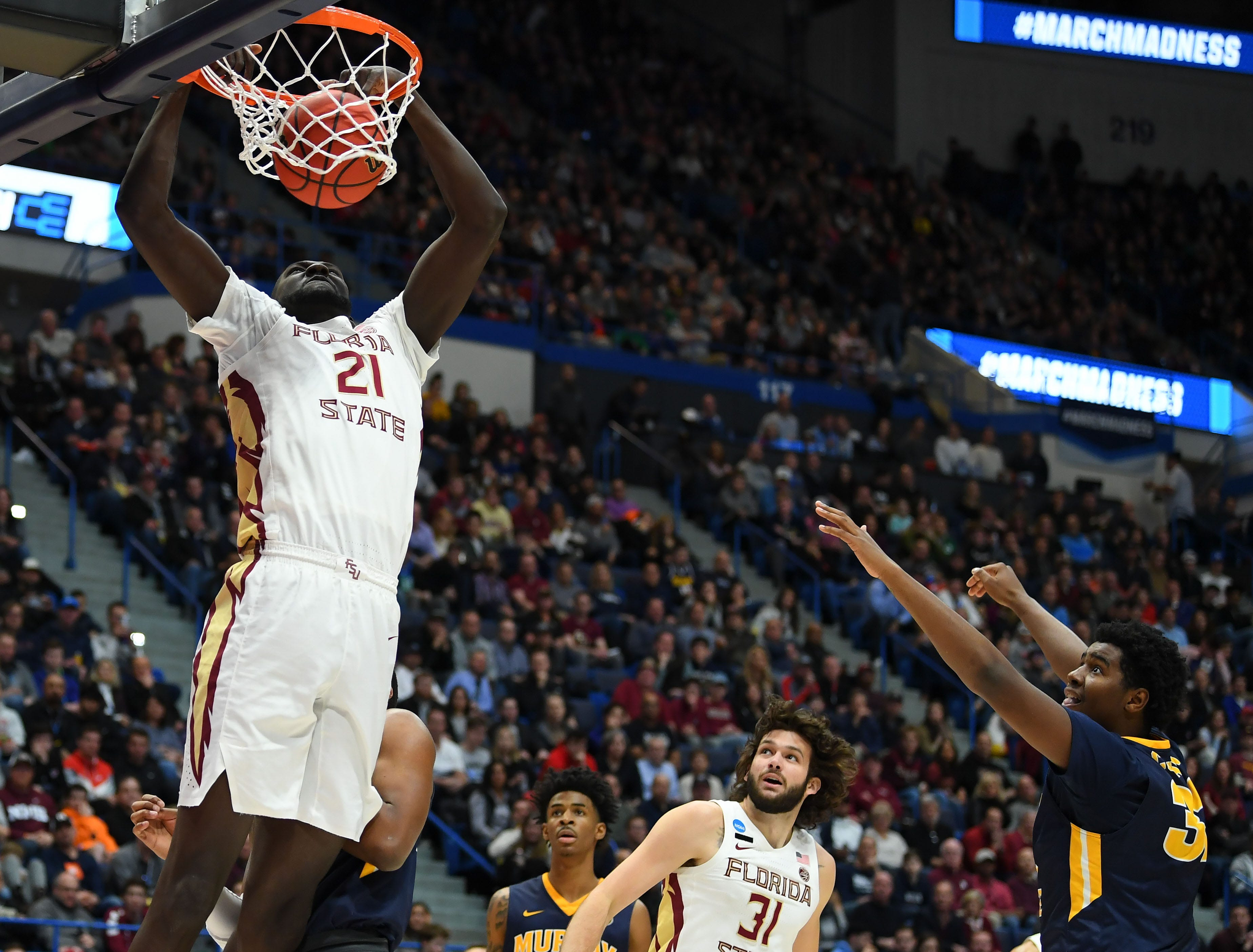 Mar 23, 2019; Hartford, CT, USA; Florida State Seminoles center Christ Koumadje (21) dunks and scores against the Murray State Racers during the first half of a game in the second round of the 2019 NCAA Tournament at XL Center. Mandatory Credit: Robert Deutsch-USA TODAY Sports