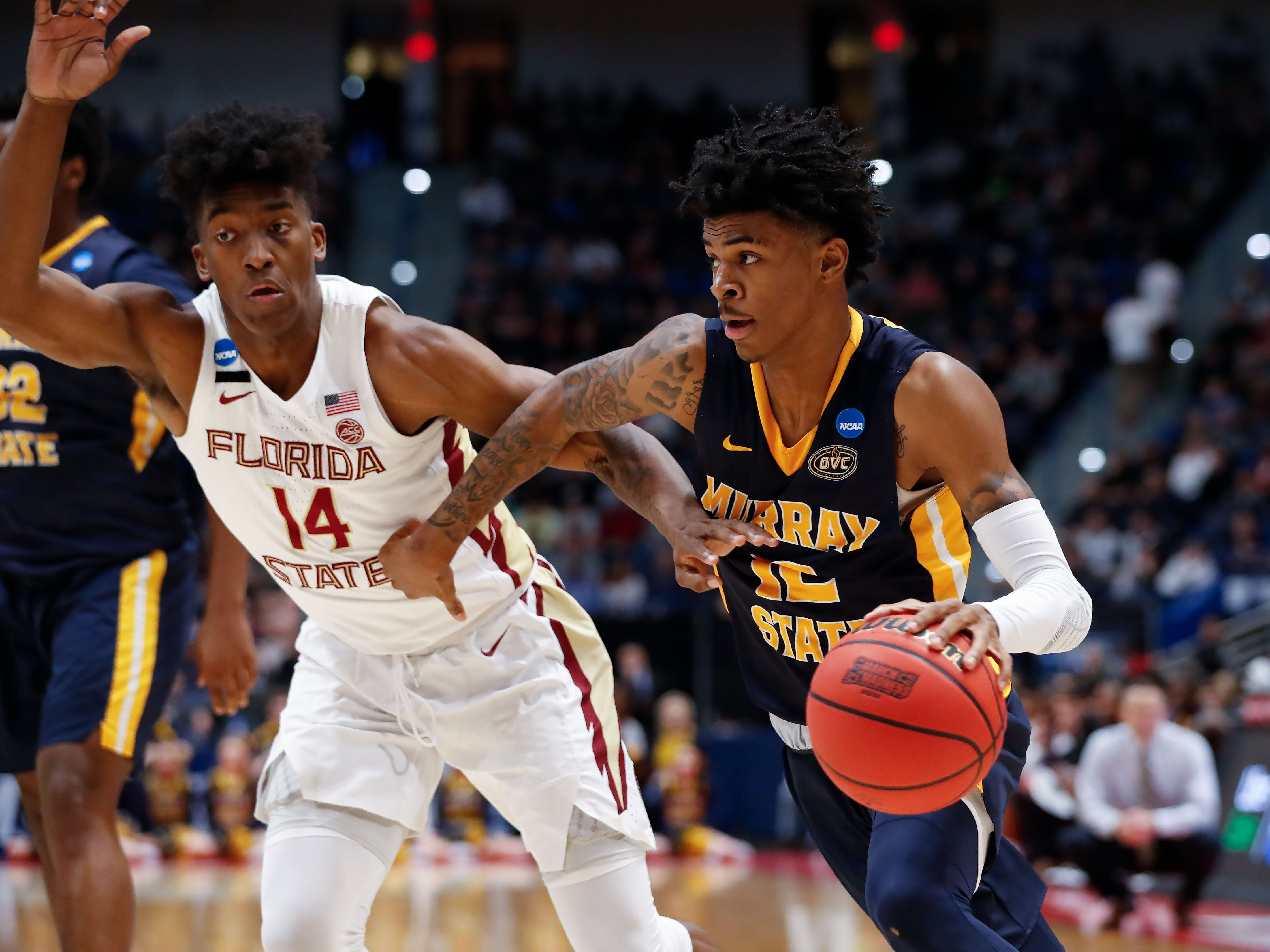 Mar 23, 2019; Hartford, CT, USA; Murray State Racers guard Ja Morant (12) drives to the basket against Florida State Seminoles guard Terance Mann (14) during the first half of a game in the second round of the 2019 NCAA Tournament at XL Center. Mandatory Credit: David Butler II-USA TODAY Sports