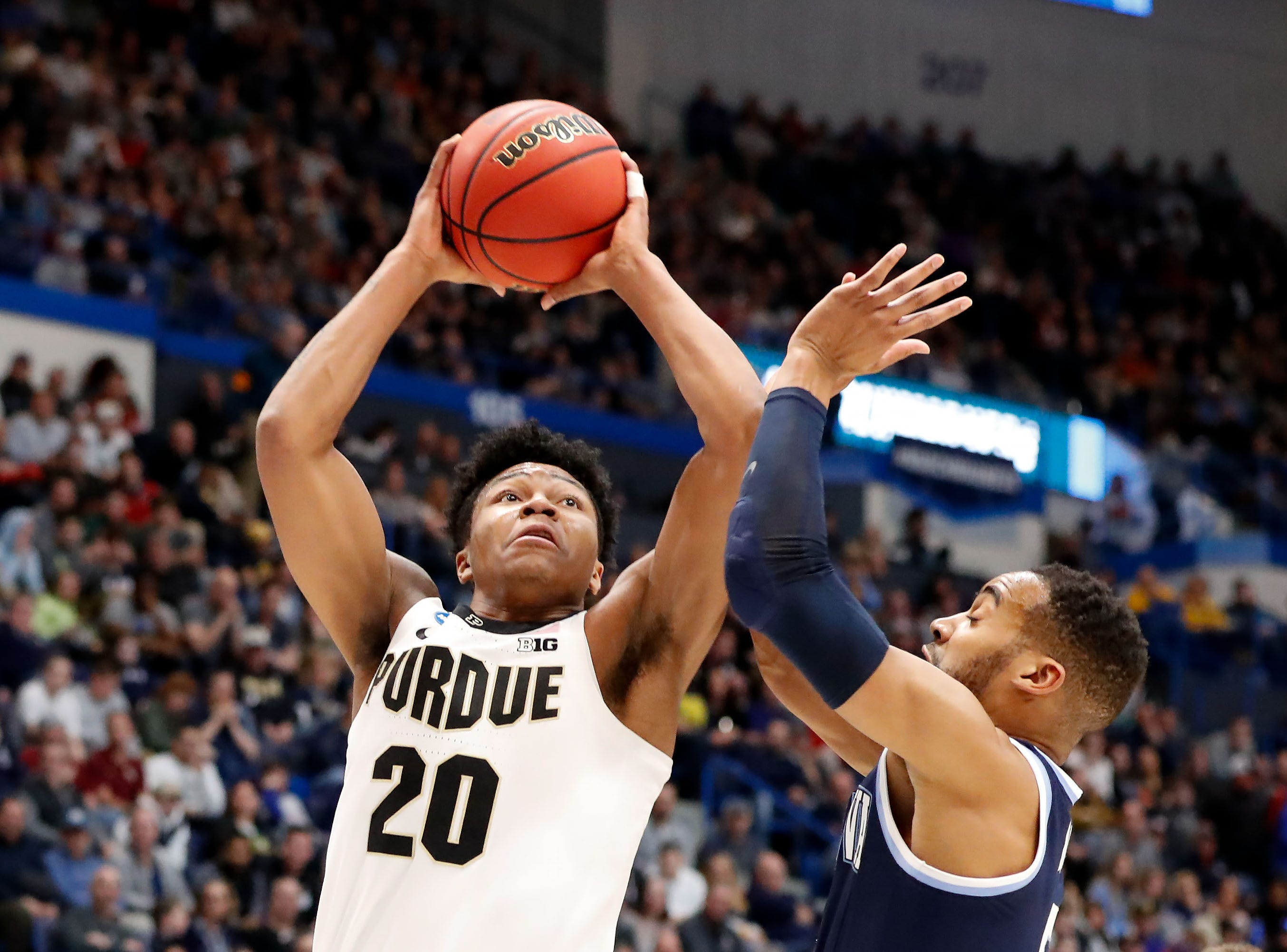 Mar 23, 2019; Hartford, CT, USA; Purdue Boilermakers guard Nojel Eastern (20) attempts a shot against Villanova Wildcats guard Phil Booth (5) during the first half of a game in the second round of the 2019 NCAA Tournament at XL Center. Mandatory Credit: David Butler II-USA TODAY Sports