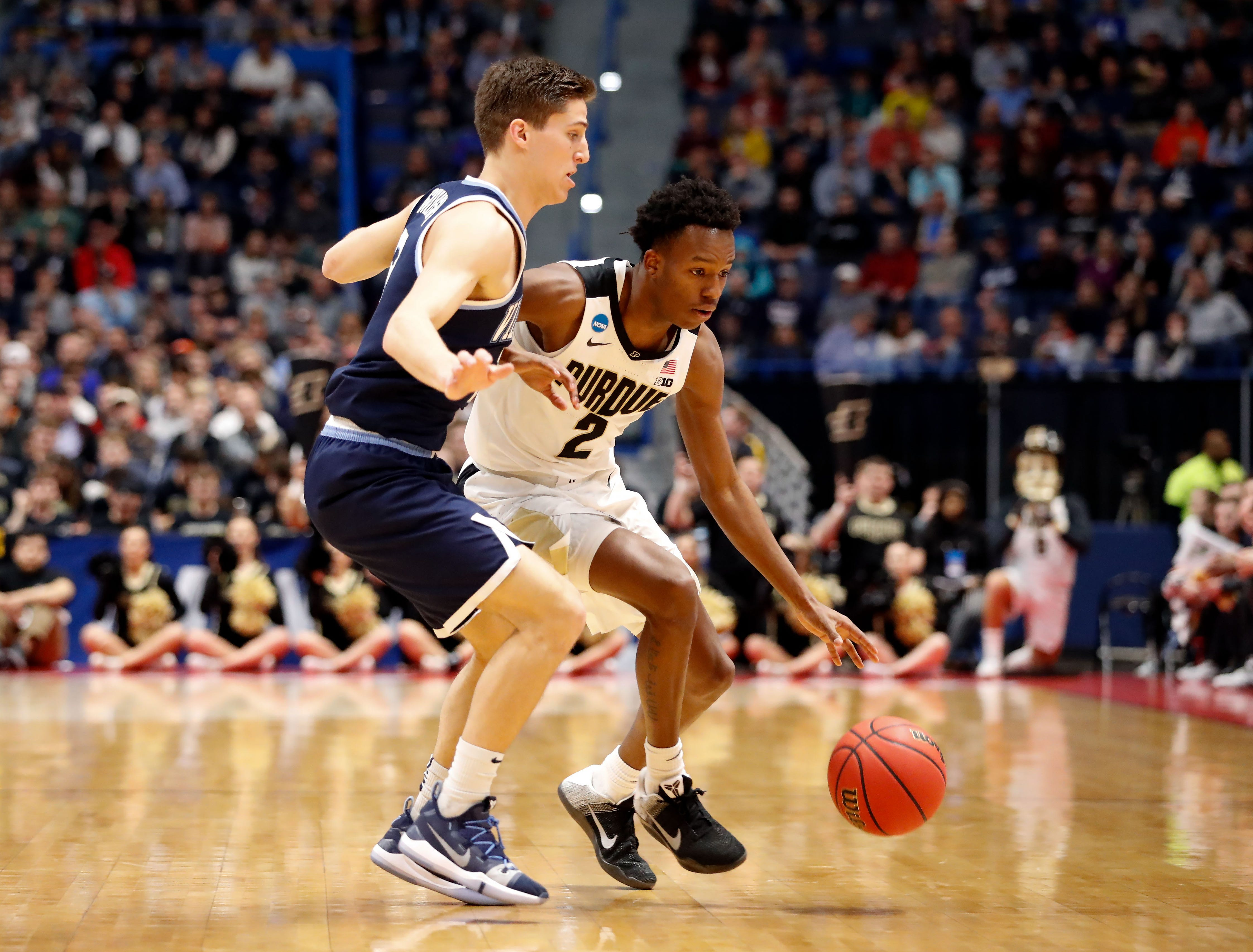 Mar 23, 2019; Hartford, CT, USA; Purdue Boilermakers guard Eric Hunter Jr. (2) controls the ball in front of Villanova Wildcats guard Collin Gillespie (2) during the first half of a game in the second round of the 2019 NCAA Tournament at XL Center. Mandatory Credit: David Butler II-USA TODAY Sports