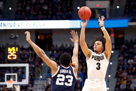 Mar 23, 2019; Hartford, CT, USA; Purdue Boilermakers guard Carsen Edwards (3) attempt a shot over Villanova Wildcats forward Jermaine Samuels (23) during the first half of a game in the second round of the 2019 NCAA Tournament at XL Center. Mandatory Credit: David Butler II-USA TODAY Sports