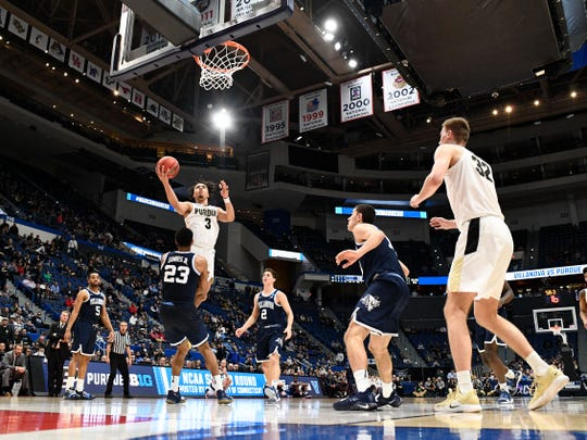 Mar 23, 2019; Hartford, CT, USA; Purdue Boilermakers guard Carsen Edwards (3) attempt a layup against the Villanova Wildcats during the second half of a game in the second round of the 2019 NCAA Tournament at XL Center. Mandatory Credit: Robert Deutsch-USA TODAY Sports
