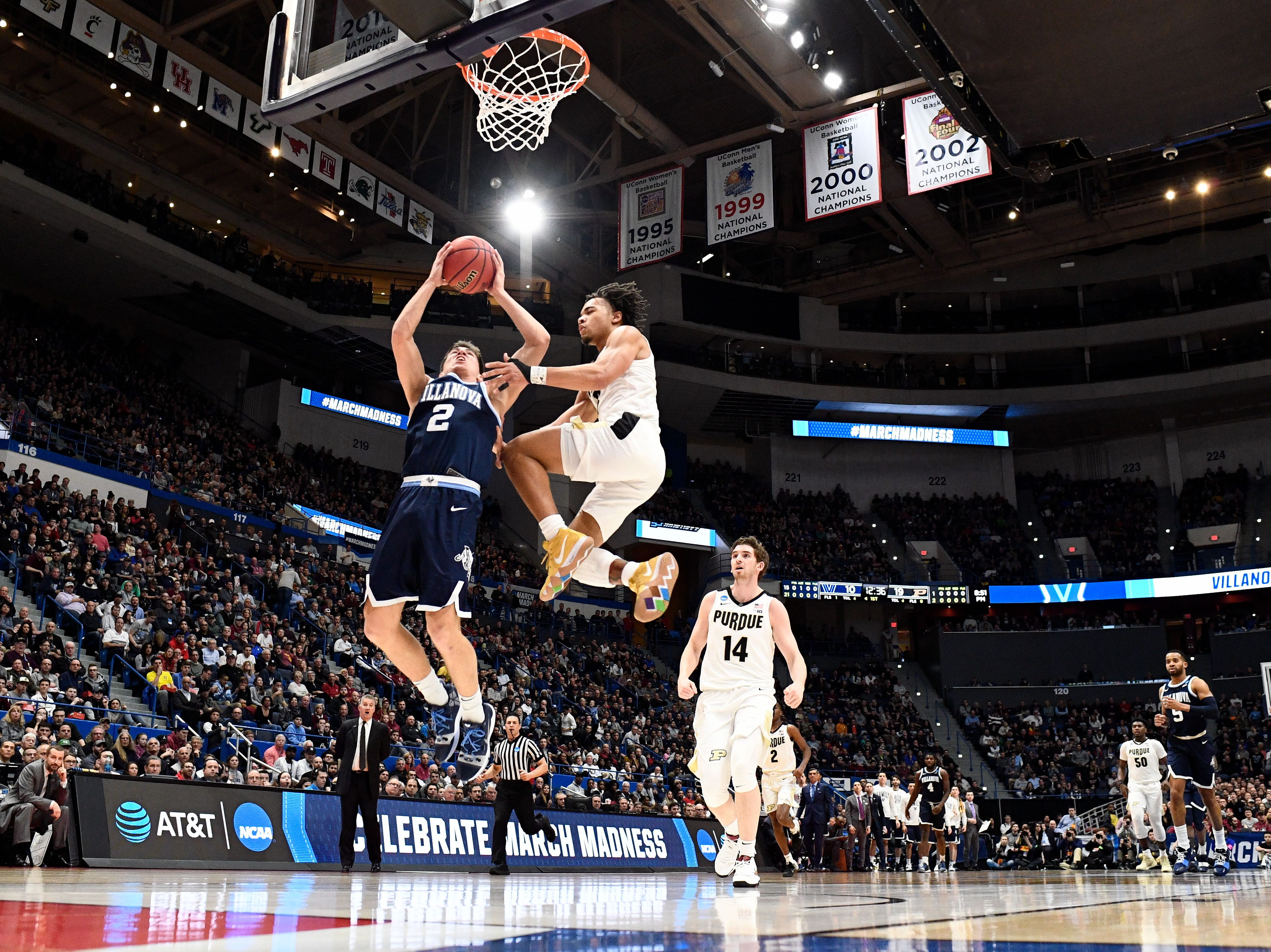 Mar 23, 2019; Hartford, CT, USA; Purdue Boilermakers guard Carsen Edwards (3) defends a layup by Villanova Wildcats guard Collin Gillespie (2) during the first half of game in the second round of the 2019 NCAA Tournament at XL Center. Mandatory Credit: Robert Deutsch-USA TODAY Sports