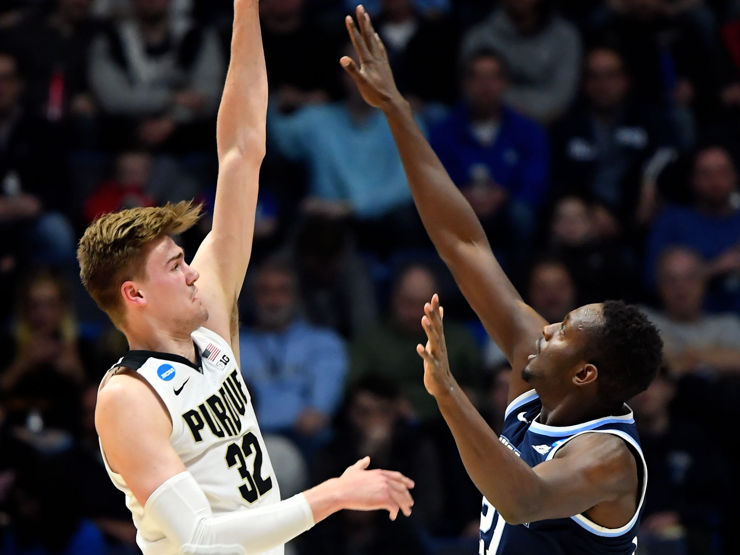 Mar 23, 2019; Hartford, CT, USA; Purdue Boilermakers center Matt Haarms (32) attempts a shot over Villanova Wildcats forward Dhamir Cosby-Roundtree (21) during the first half of game in the second round of the 2019 NCAA Tournament at XL Center. Mandatory Credit: Robert Deutsch-USA TODAY Sports