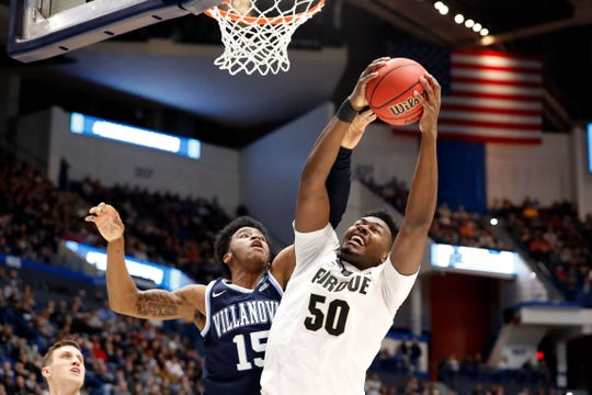 Mar 23, 2019; Hartford, CT, USA; Purdue Boilermakers forward Trevion Williams (50) rebounds the ball in front of Villanova Wildcats forward Saddiq Bey (15) during the first half of a game in the second round of the 2019 NCAA Tournament at XL Center. Mandatory Credit: David Butler II-USA TODAY Sports