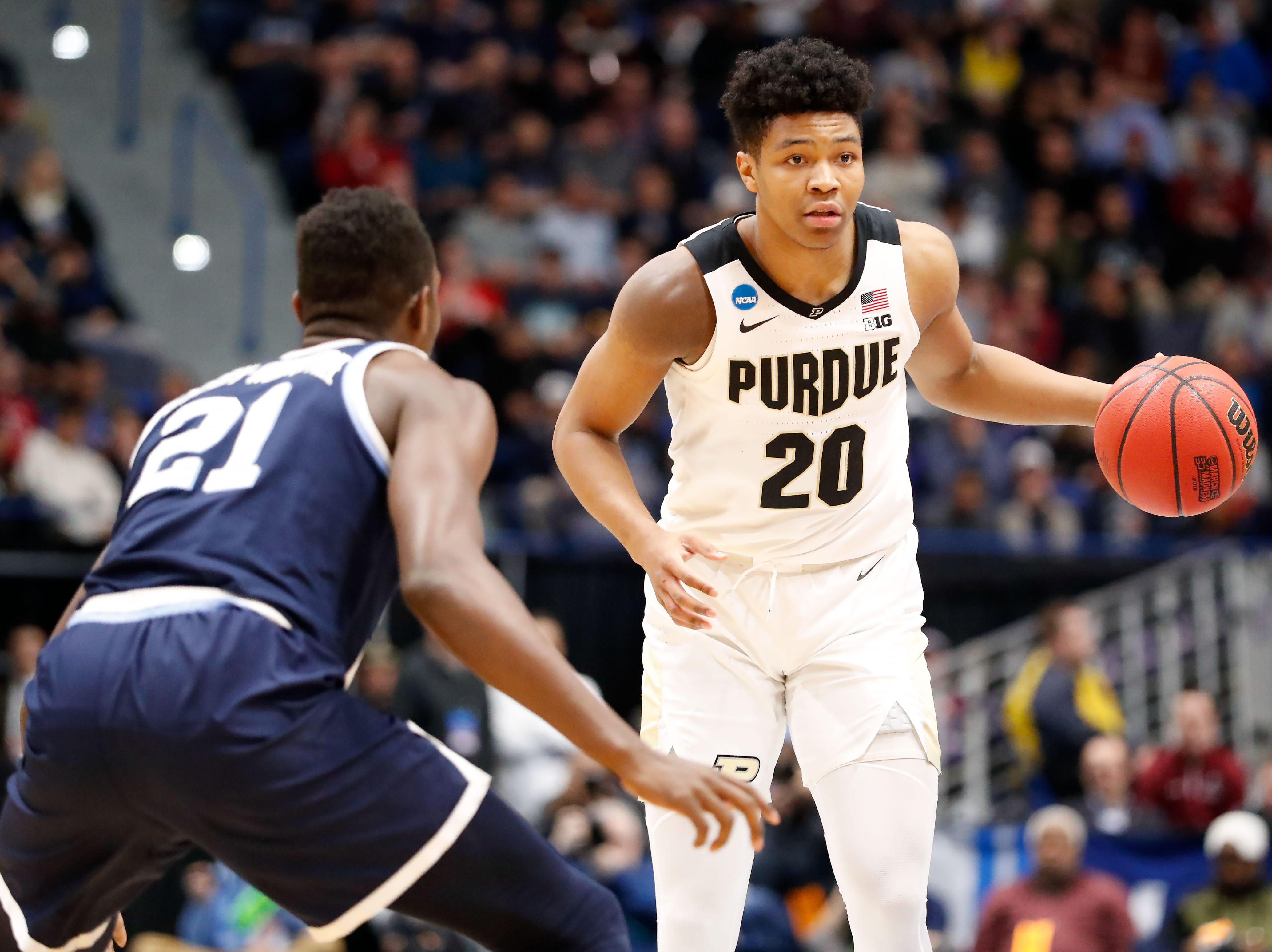 Mar 23, 2019; Hartford, CT, USA; Purdue Boilermakers guard Nojel Eastern (20) dribbles the ball around Villanova Wildcats forward Dhamir Cosby-Roundtree (21) during the first half of a game in the second round of the 2019 NCAA Tournament at XL Center. Mandatory Credit: David Butler II-USA TODAY Sports