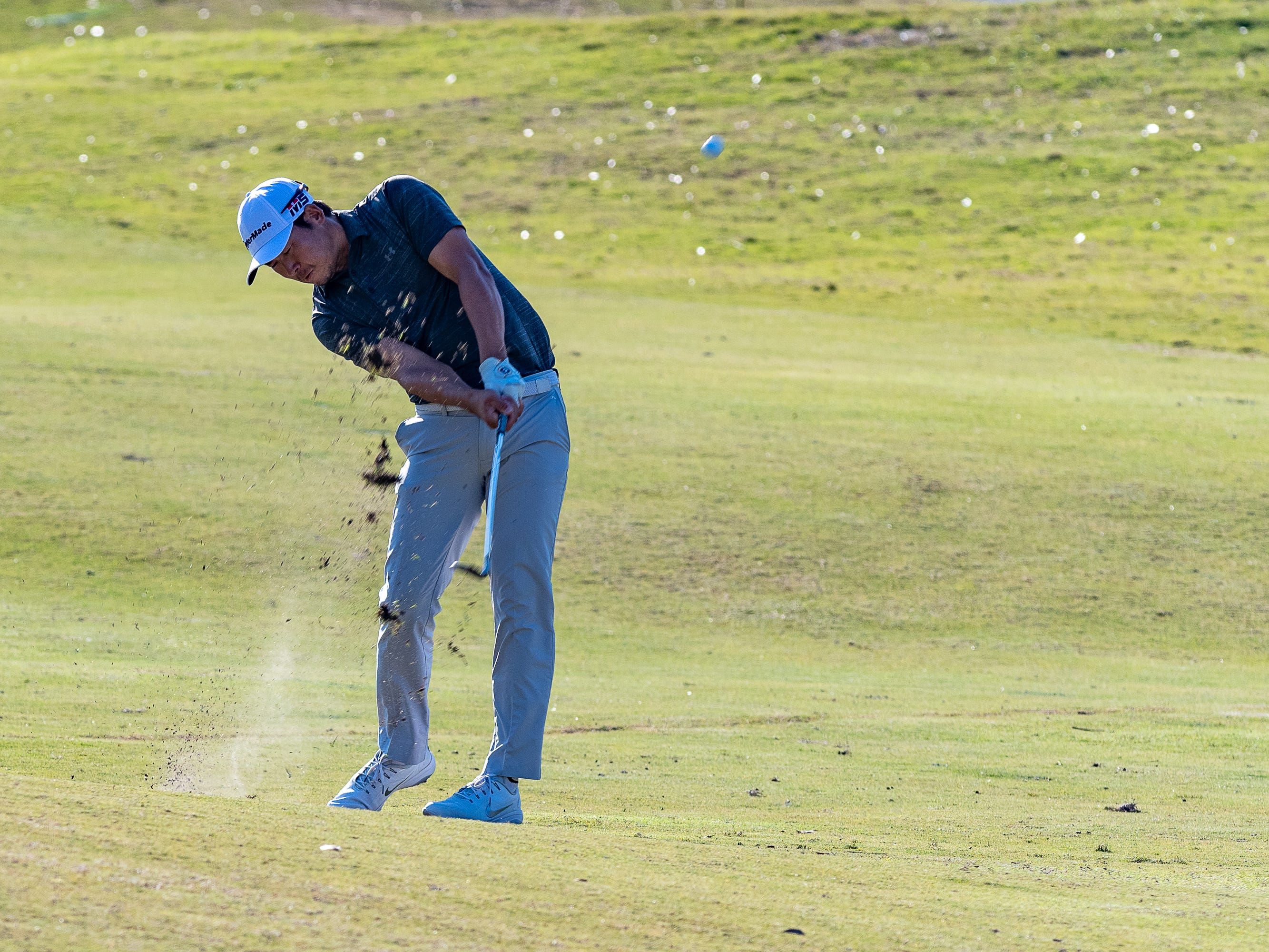 Zhang Xlnjun hits approach shot on 18 during the third round of The Web.com Tour in Lafayette for the 2019 Chitimacha Louisiana Open at Le Triomphe. Saturday, March 23, 2019.