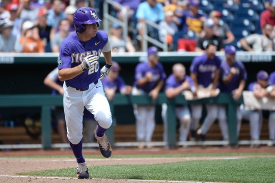 LSU Tigers outfielder Antoine Duplantis (20) drives in a run in the third inning against the Oregon State Beavers at TD Ameritrade Park Omaha.