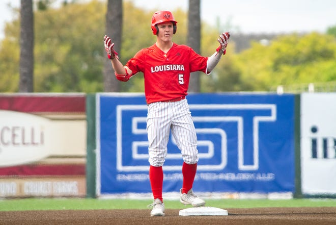 """UL's Hayden Cantrelle celebrates on second base as the Ragin' Cajuns take on the Appalachian State Mountaineers at M.L. """"Tigue"""" Moore Field on Sunday, March 24, 2019."""