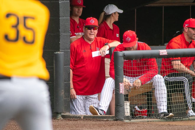 """UL's head baseball coach Tony Robichaux watches the game from the dugout as the Ragin' Cajuns take on the Appalachian State Mountaineers at M.L. """"Tigue"""" Moore Field on Sunday, March 24, 2019."""
