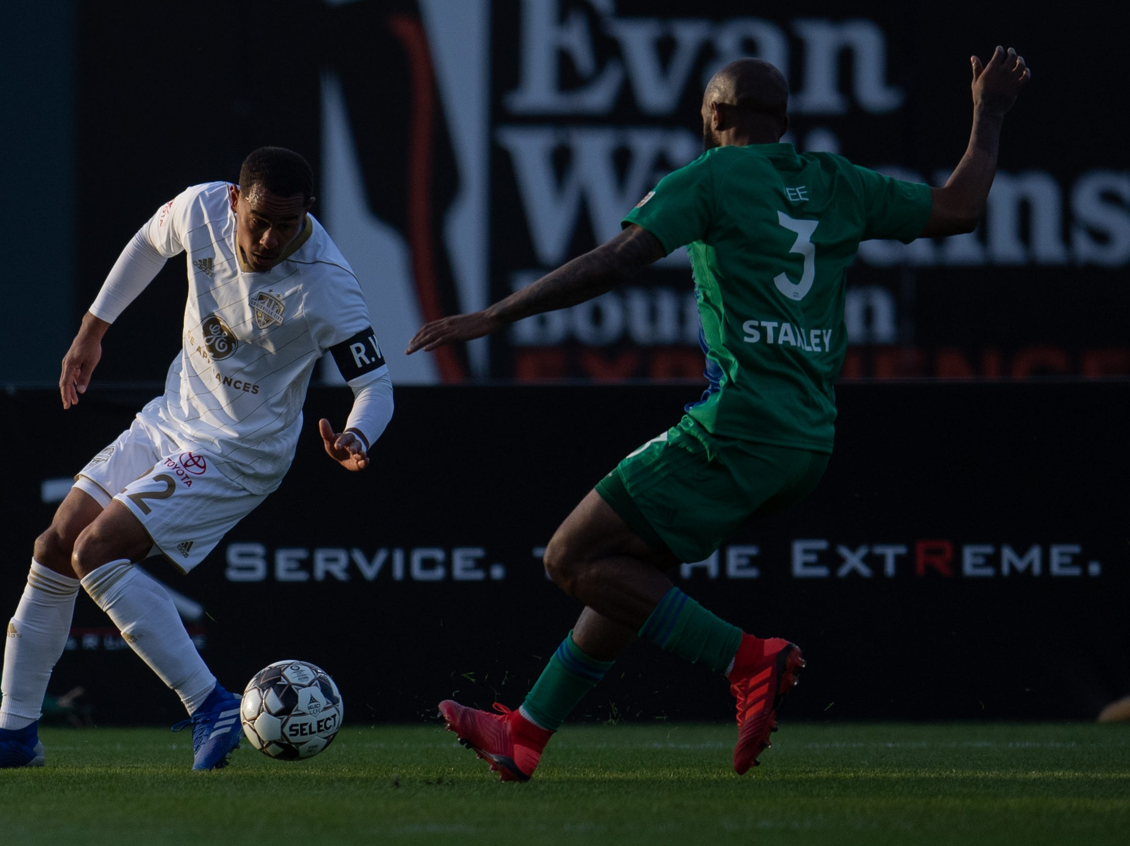 Louisville City FC midfielder George Davis IV plays against Hartford Athletic Raymond Lee during the season opening match in Louisville, Ky., Saturday, March 23, 2019.