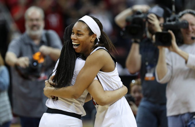 U of L's Asia Durr (25) embraced teammate Arica Carter (11) after their 71-50 defeat of Michigan in the second round of their NCAA Tournament game at the Yum Center.  They advance to the Sweet 16 in the Albany regional.Mar. 24, 2019