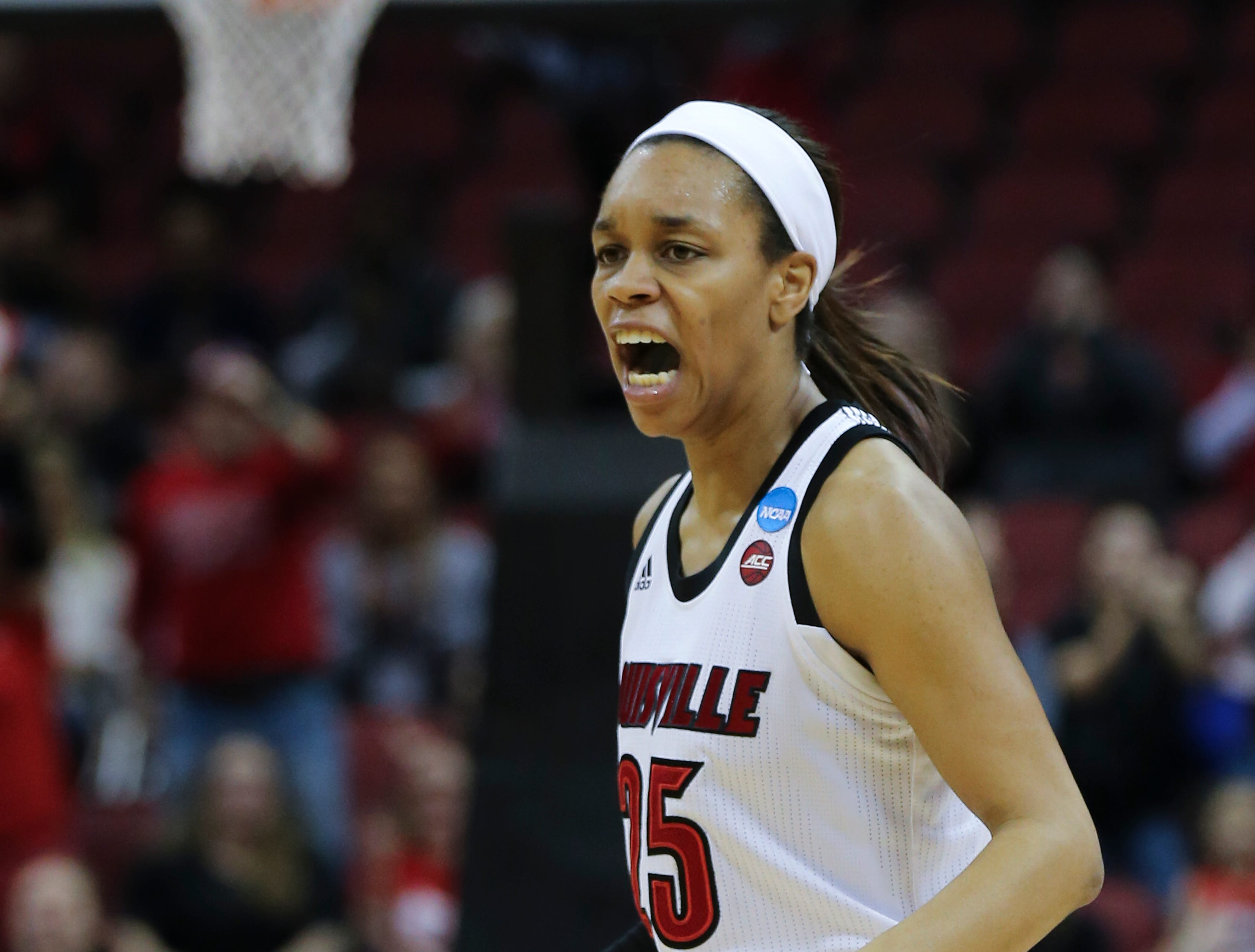 U of L's Asia Durr (25) reacts after hitting a three-point shot against against Michigan during the second round of their NCAA Tournament game at the Yum Center.Mar. 24, 2019