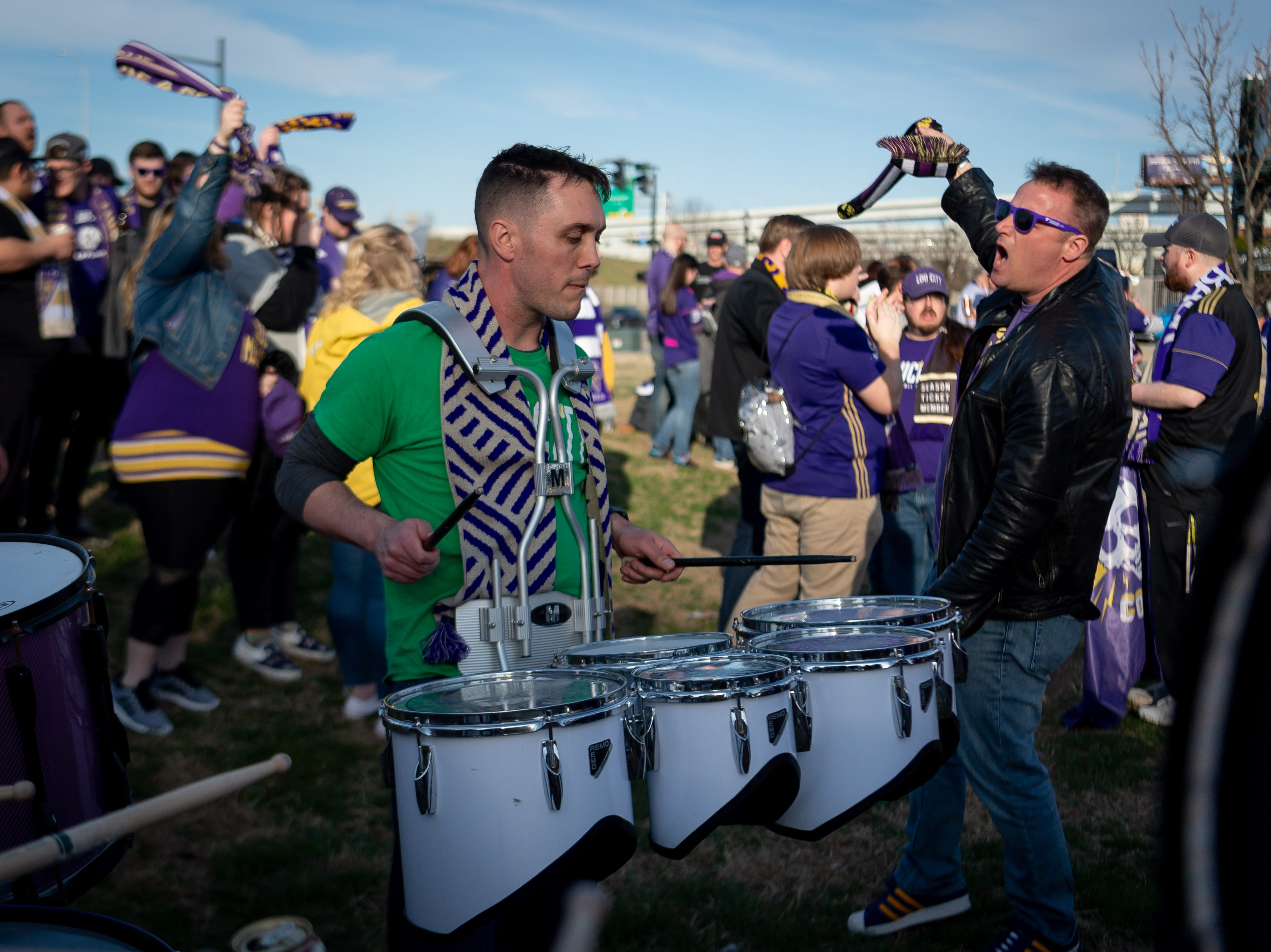Louisville City Football Club fans celebrate before the match in Louisville, Ky., Saturday, March 23, 2019.