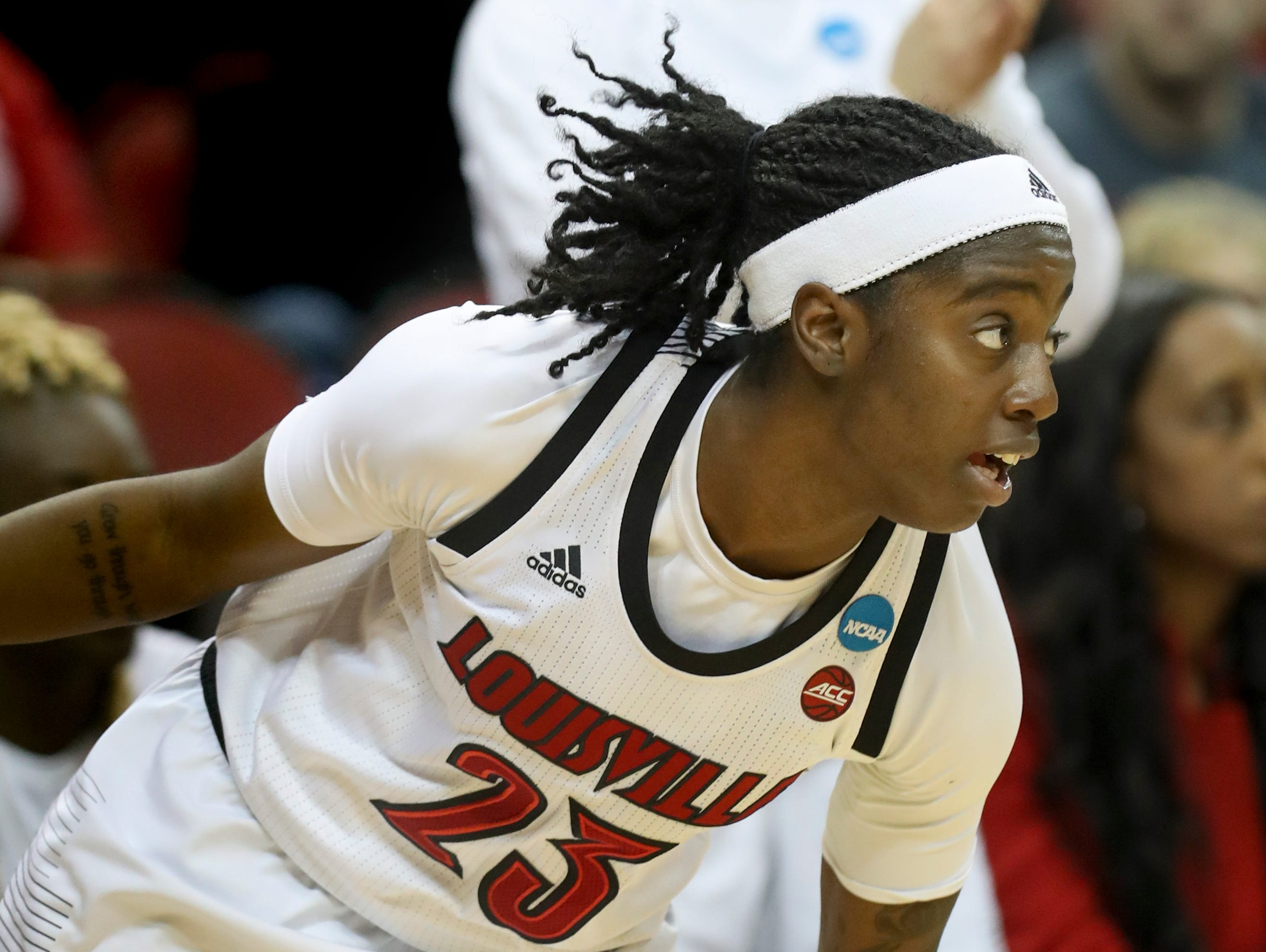 Louisville's Jazmine Jones tracks down a loose ball during the game against Michigan at the KFC Yum Center on March 24.