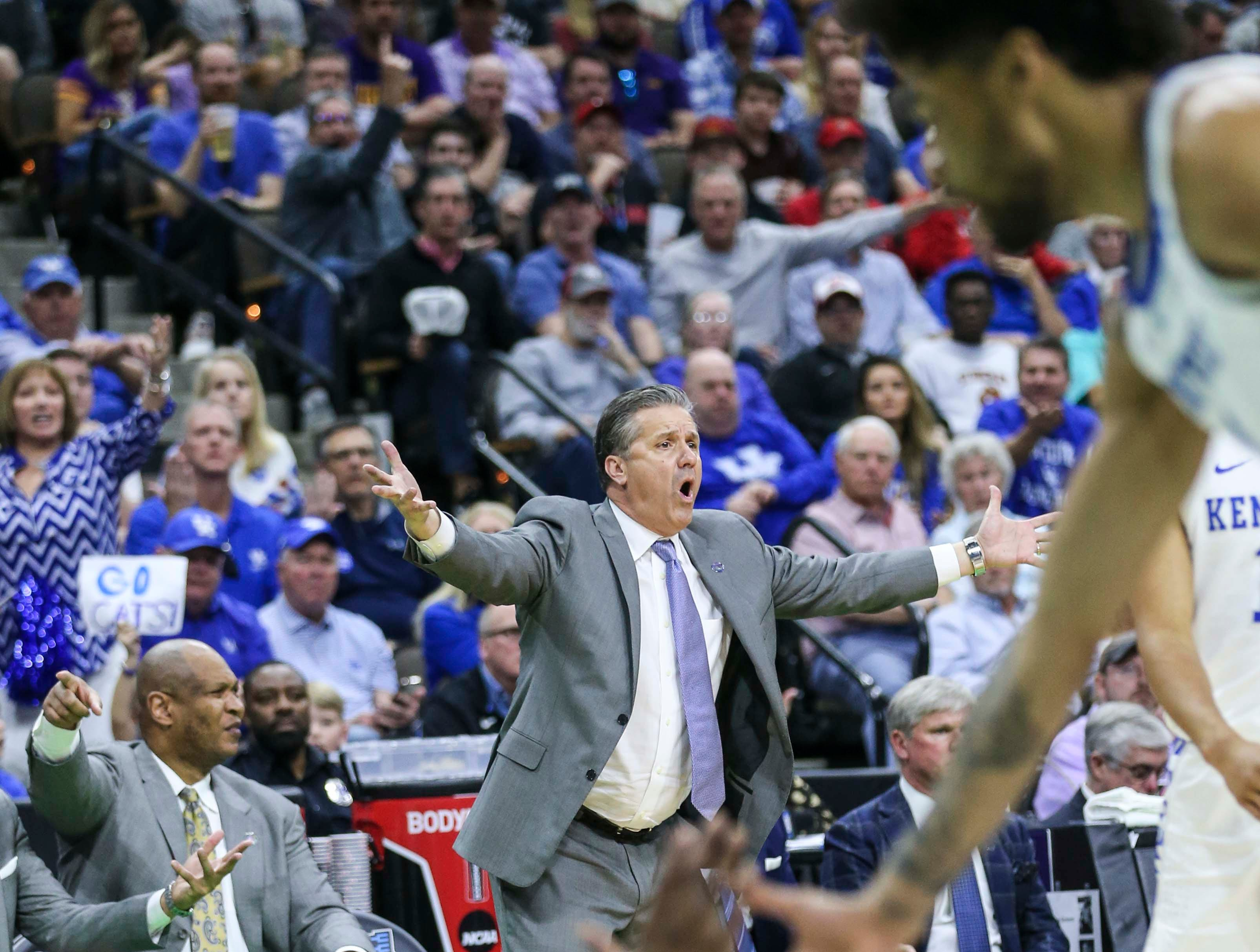 Kentucky's John Calipari couldn't believe that  Ashton Hagans wasn't fouled in the Wildcats' 62-56 win in the second round game of the 2019 NCAA tournament in Jacksonville, Fla. March 23, 2019