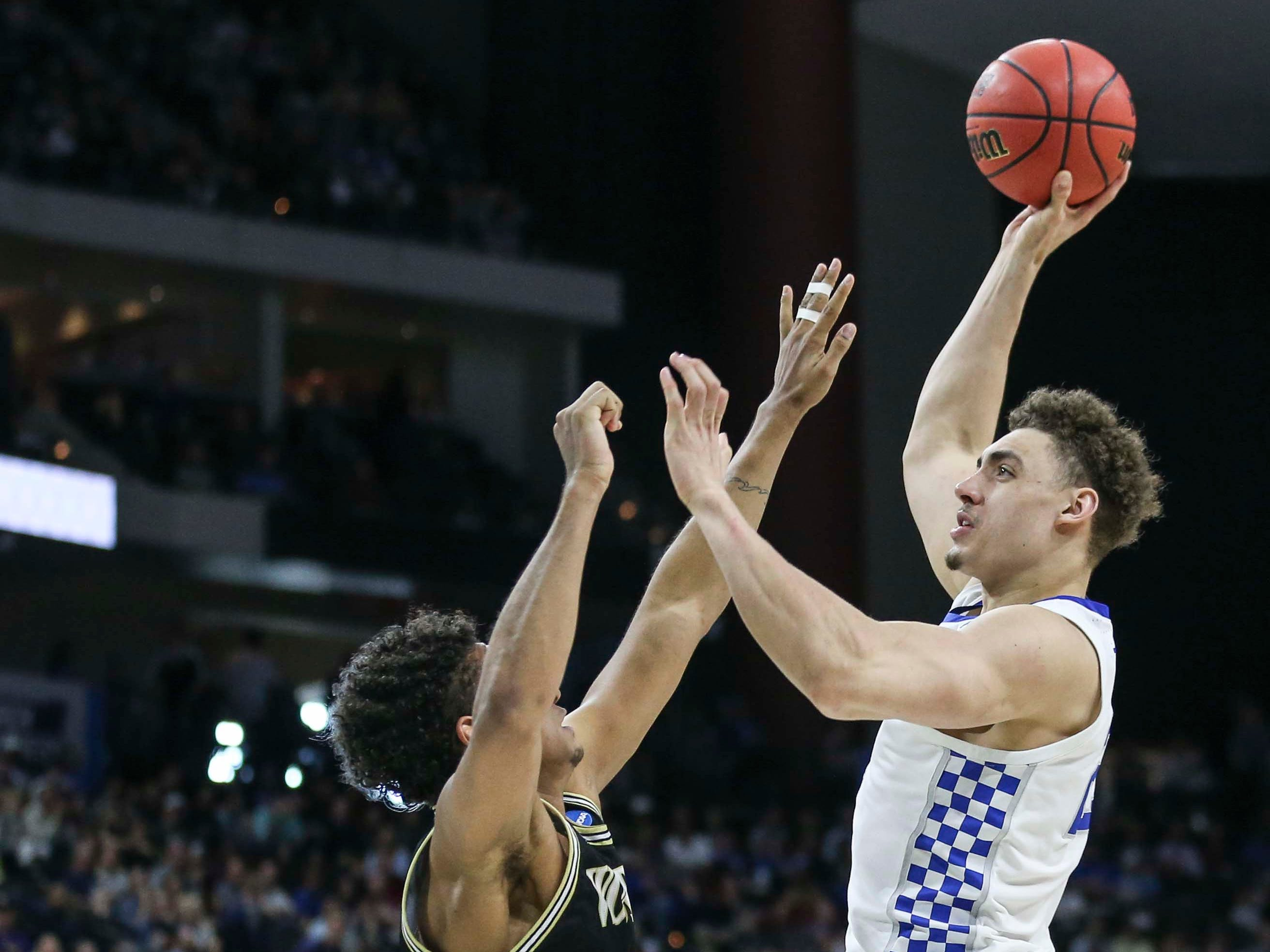 Kentucky's Reid Travis scored 14 points with 11 rebounds as he helped lead the Wildcats' 62-56 win in the second round game of the 2019 NCAA tournament in Jacksonville, Fla. March 23, 2019