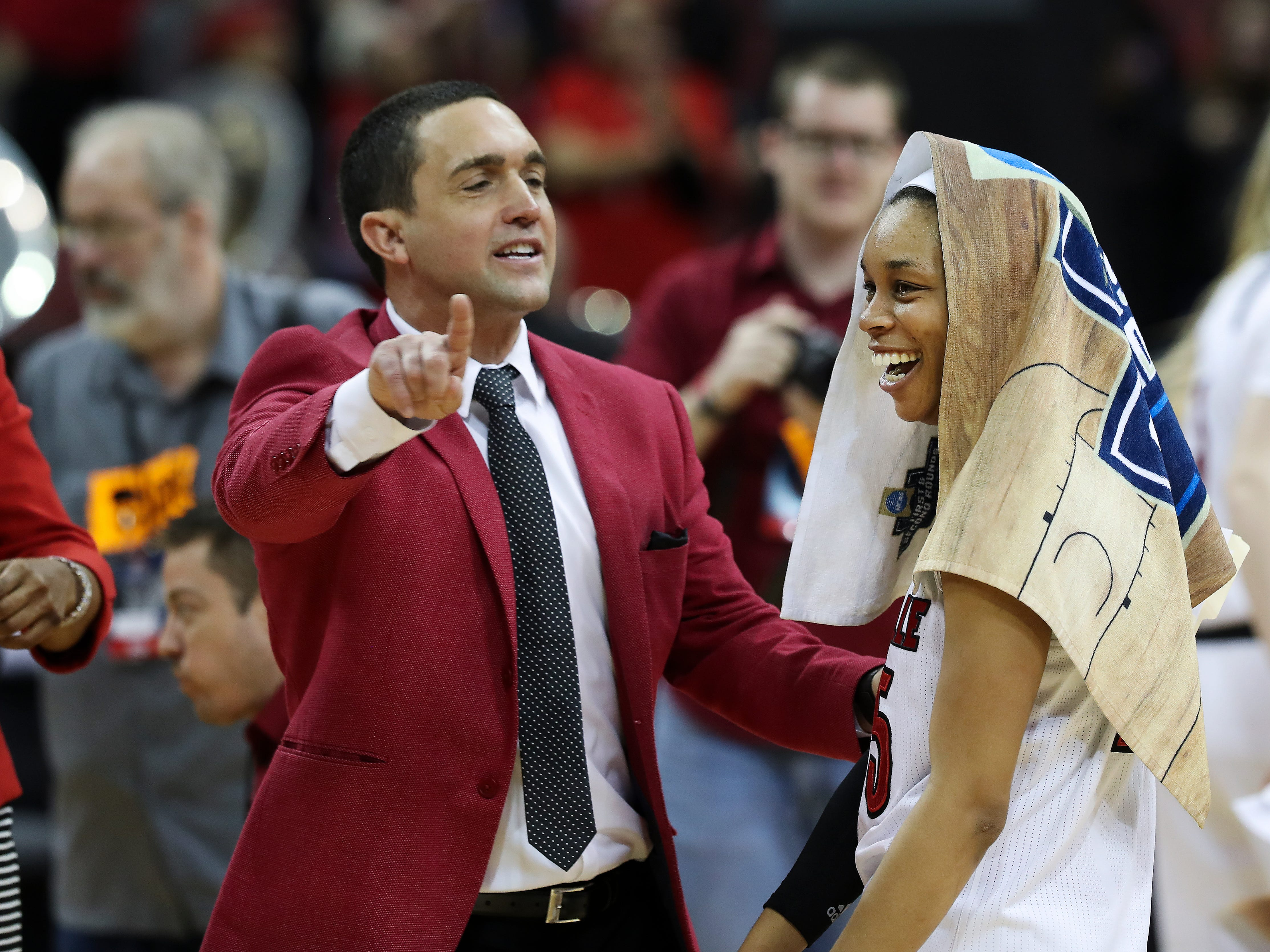 U of L Associate Coach Sam Purcell made sure Asia Durr (25) took a victory lap to the fans after their 71-50 defeat of Michigan in the second round of their NCAA Tournament game at the Yum Center.  They advance to the Sweet 16 in the Albany regional.Mar. 24, 2019