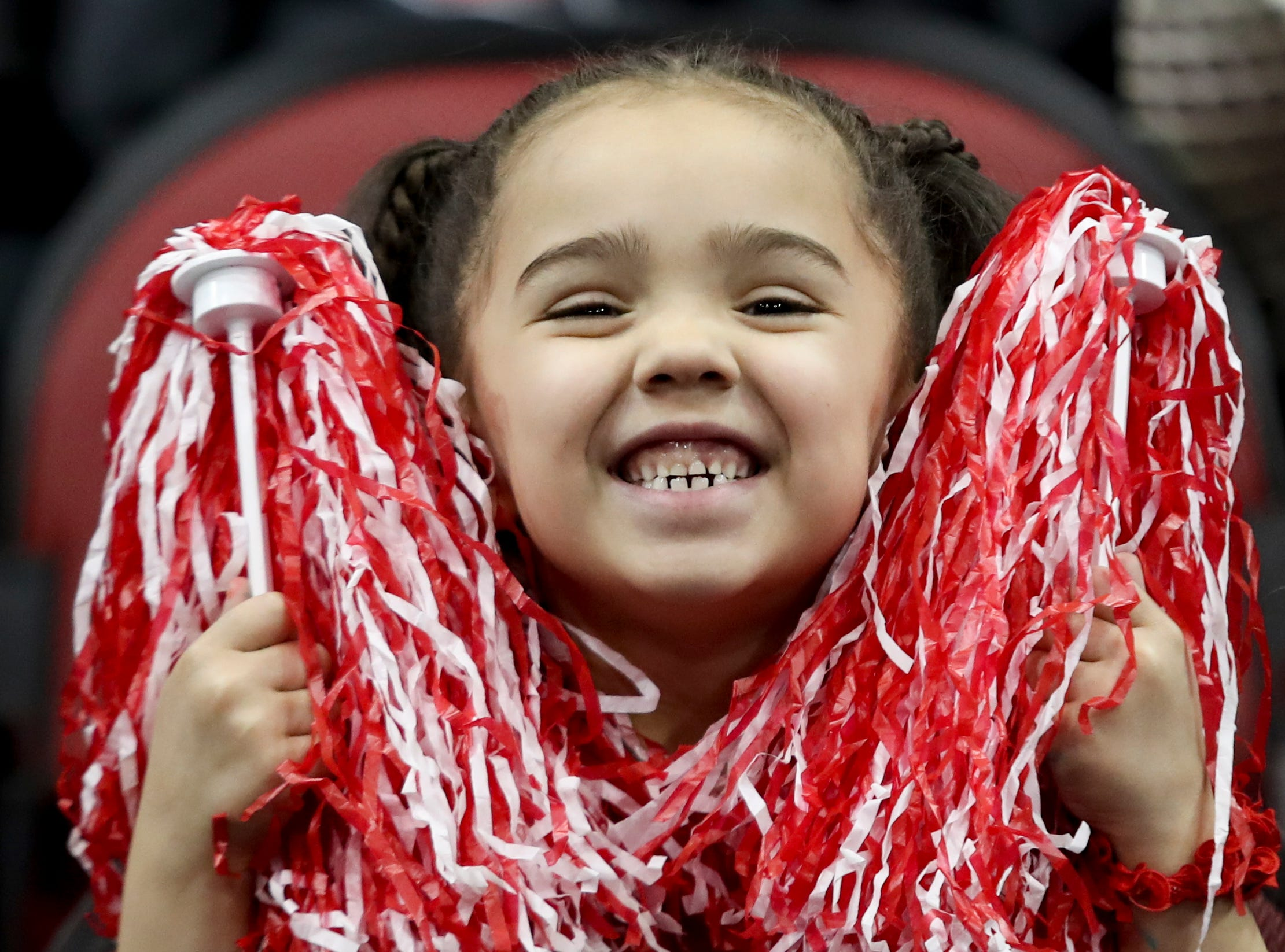 This Louisville fan is all smiles at the game against Michigan at the KFC Yum Center on March 24.