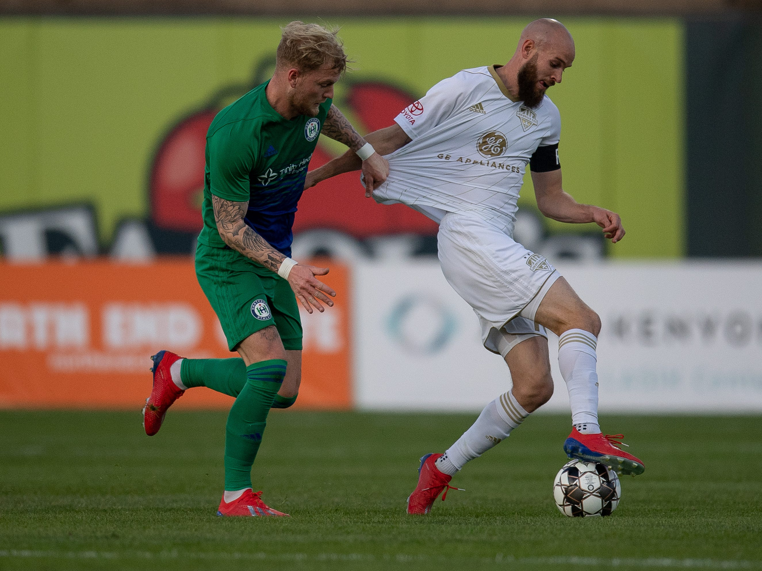 Louisville City FC midfielder Brian Ownby (10) plays against Hartford Athletic Set de Wit during the season opening match in Louisville, Ky., Saturday, March 23, 2019.