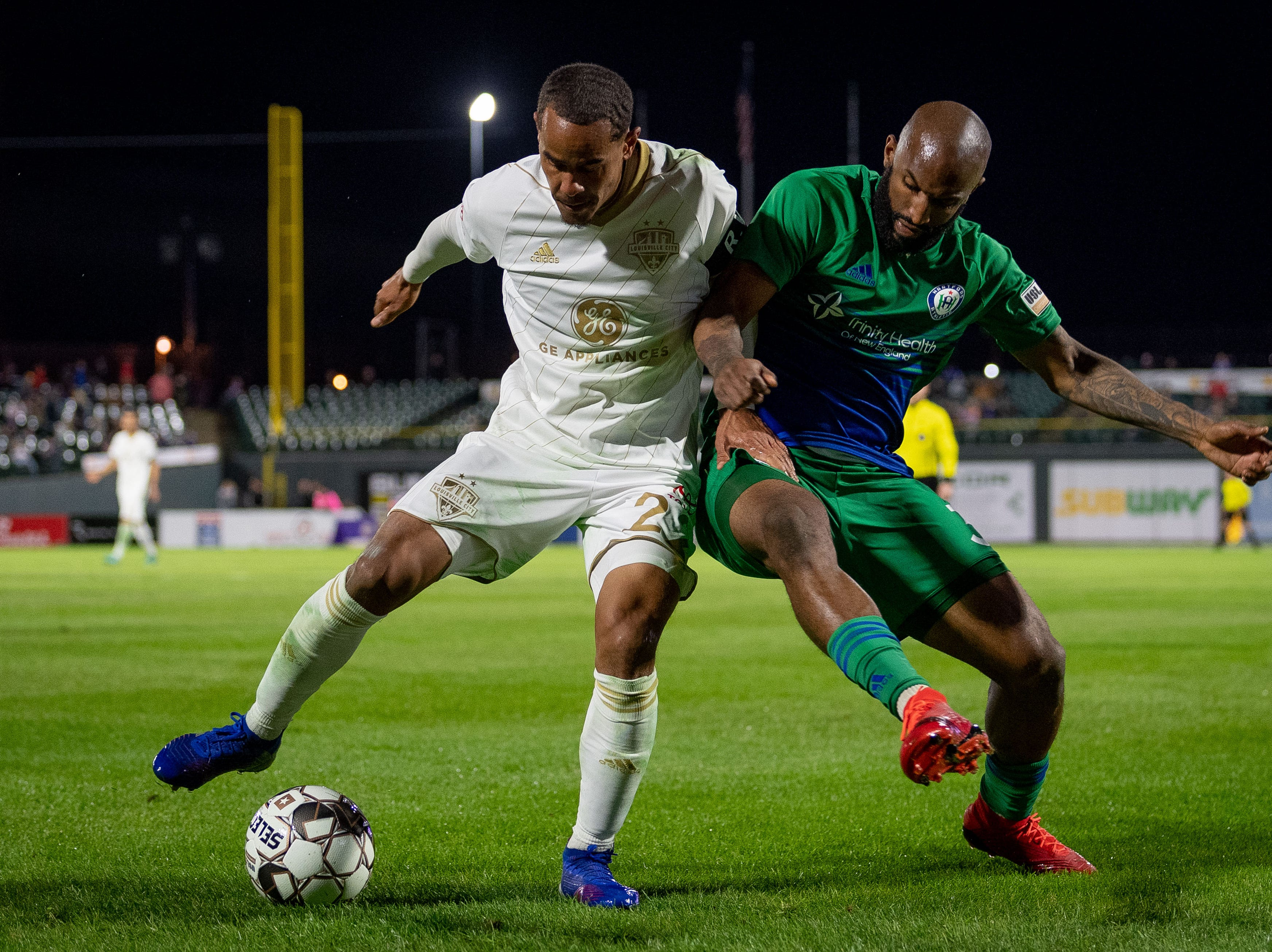 Louisville City FC midfielder George Davis IV (22) plays against Raymond Lee (3) during the season opening match in Louisville, Ky., Saturday, March 23, 2019.
