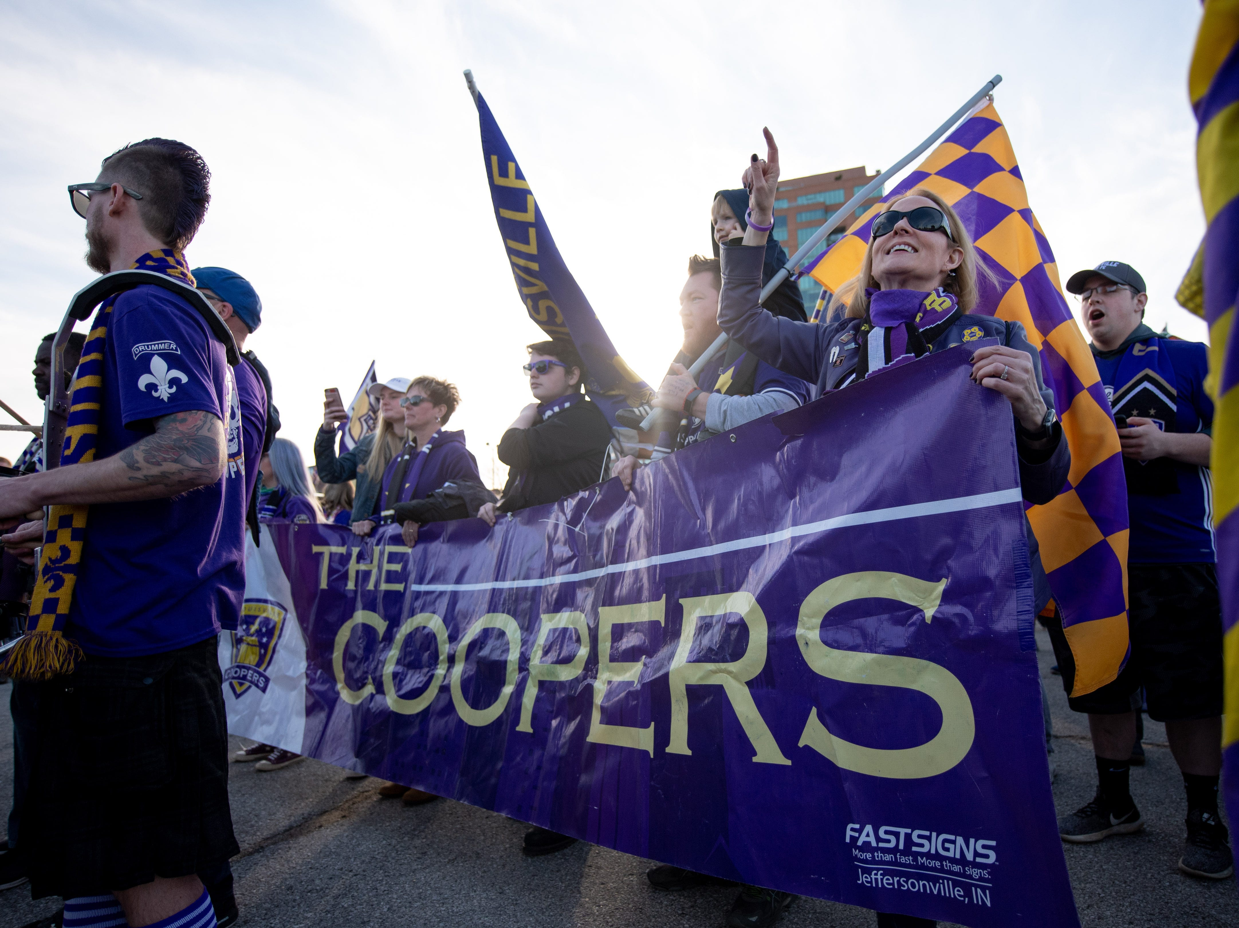 Louisville City FC fans celebrate before the match in Louisville, Ky., Saturday, March 23, 2019.
