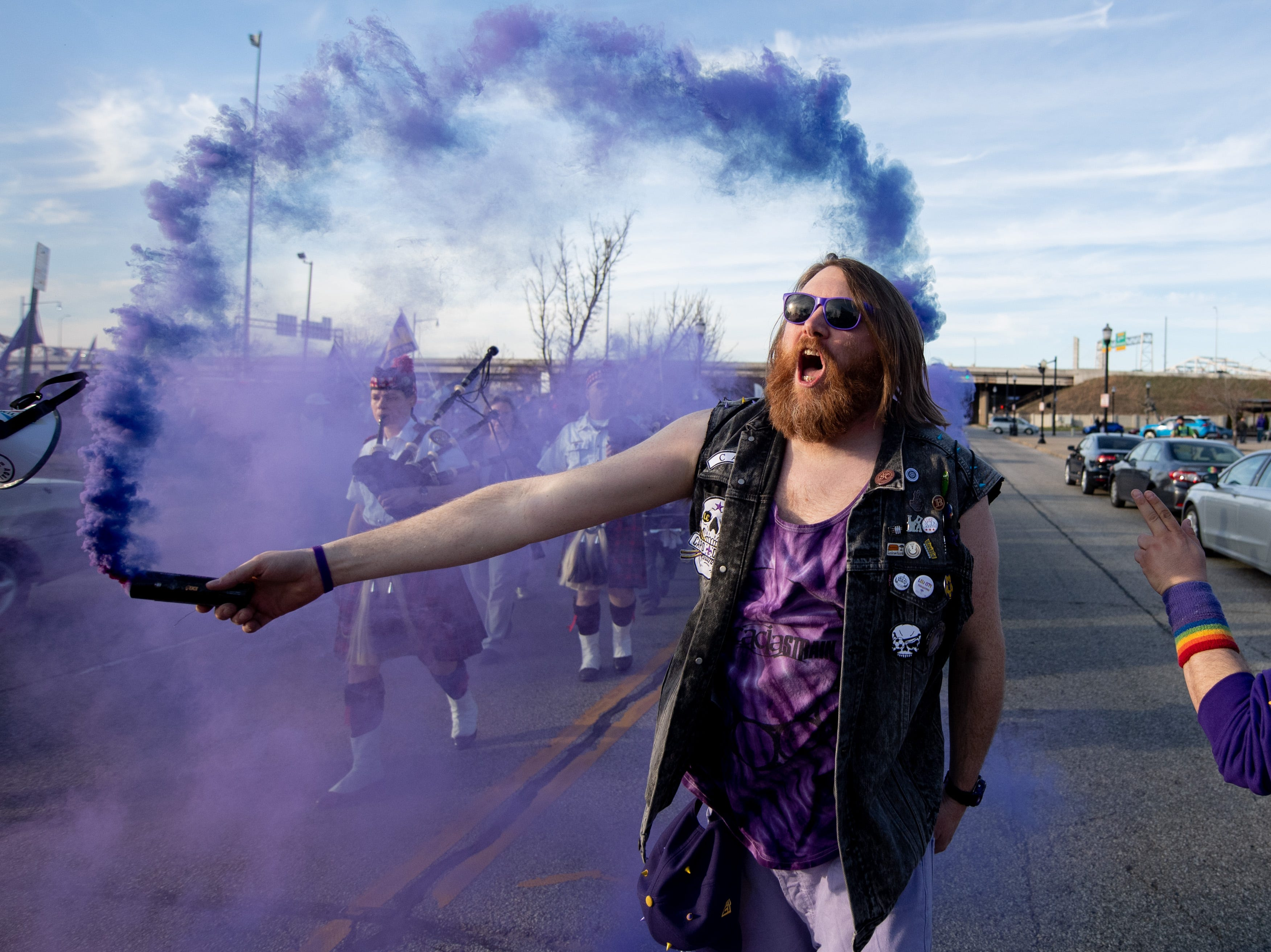 Louisville City FC fans Glenn McGlenn leads fans up Preston street on their way to the match in Louisville, Ky., Saturday, March 23, 2019.