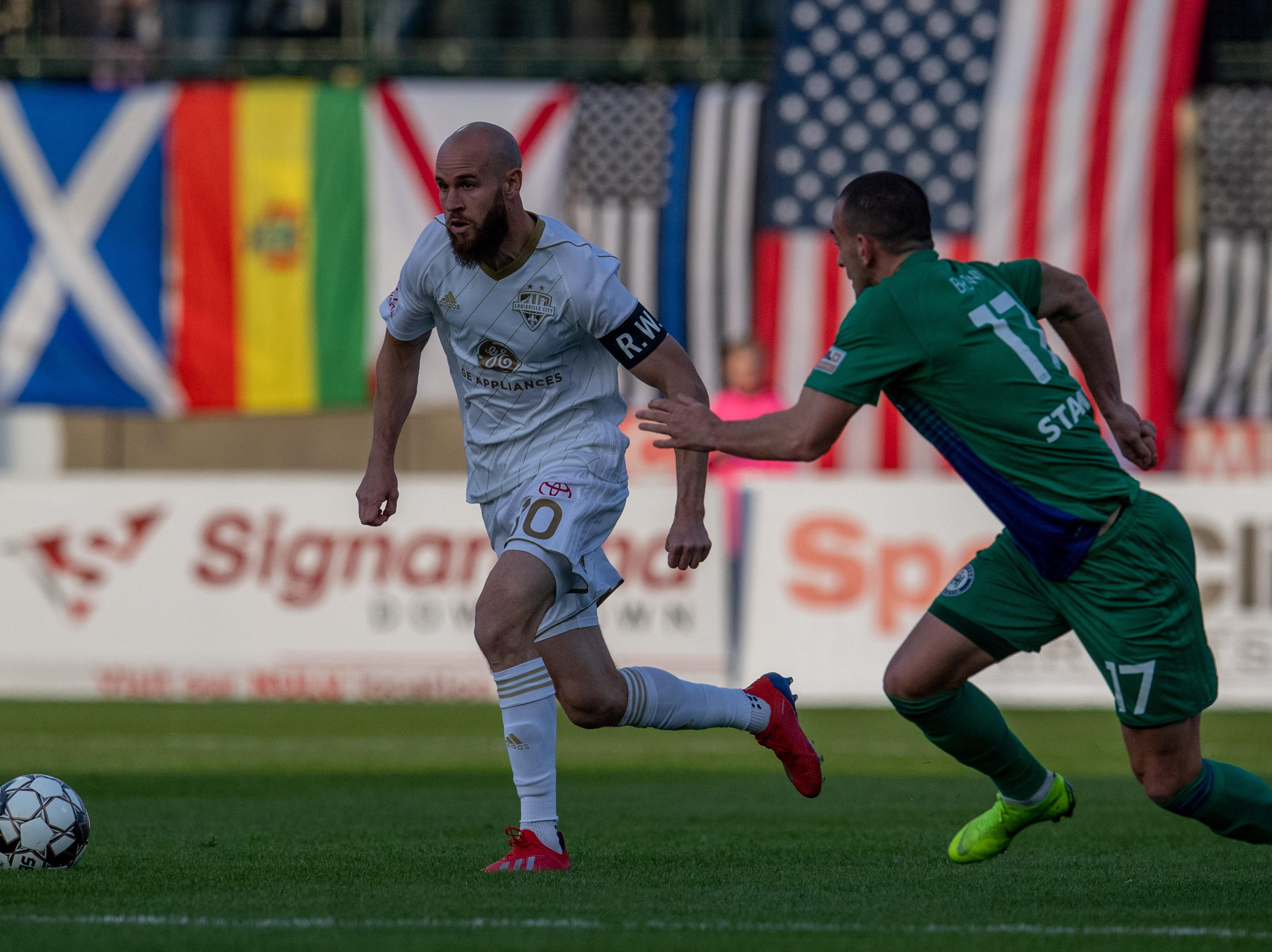 Louisville City FC midfielder Brian Ownby (10) plays against Hartford Athletic Jonathan Brown during the season opening match in Louisville, Ky., Saturday, March 23, 2019.