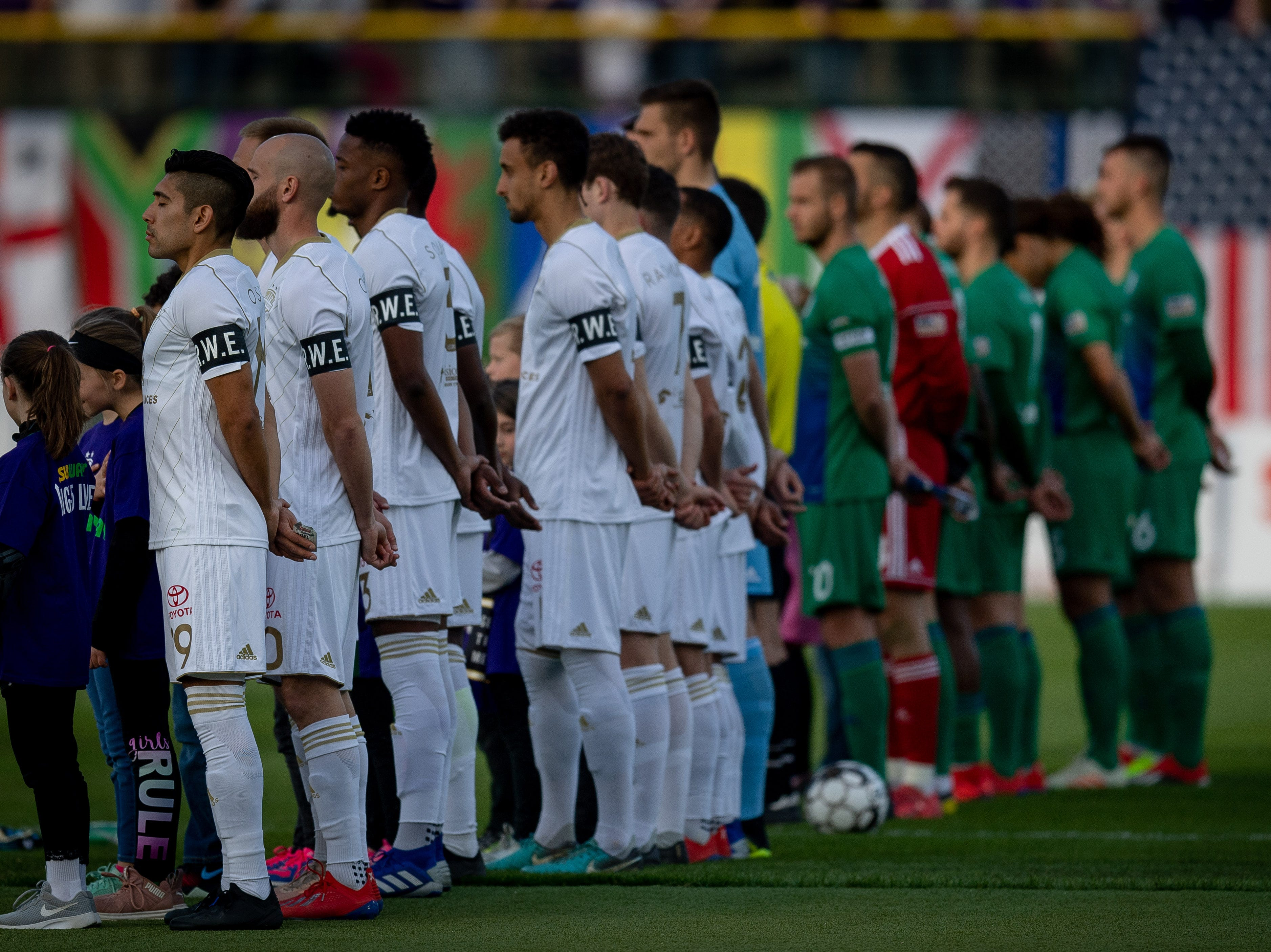 Louisville City FC players line up for their match in Louisville, Ky., Saturday, March 23, 2019.
