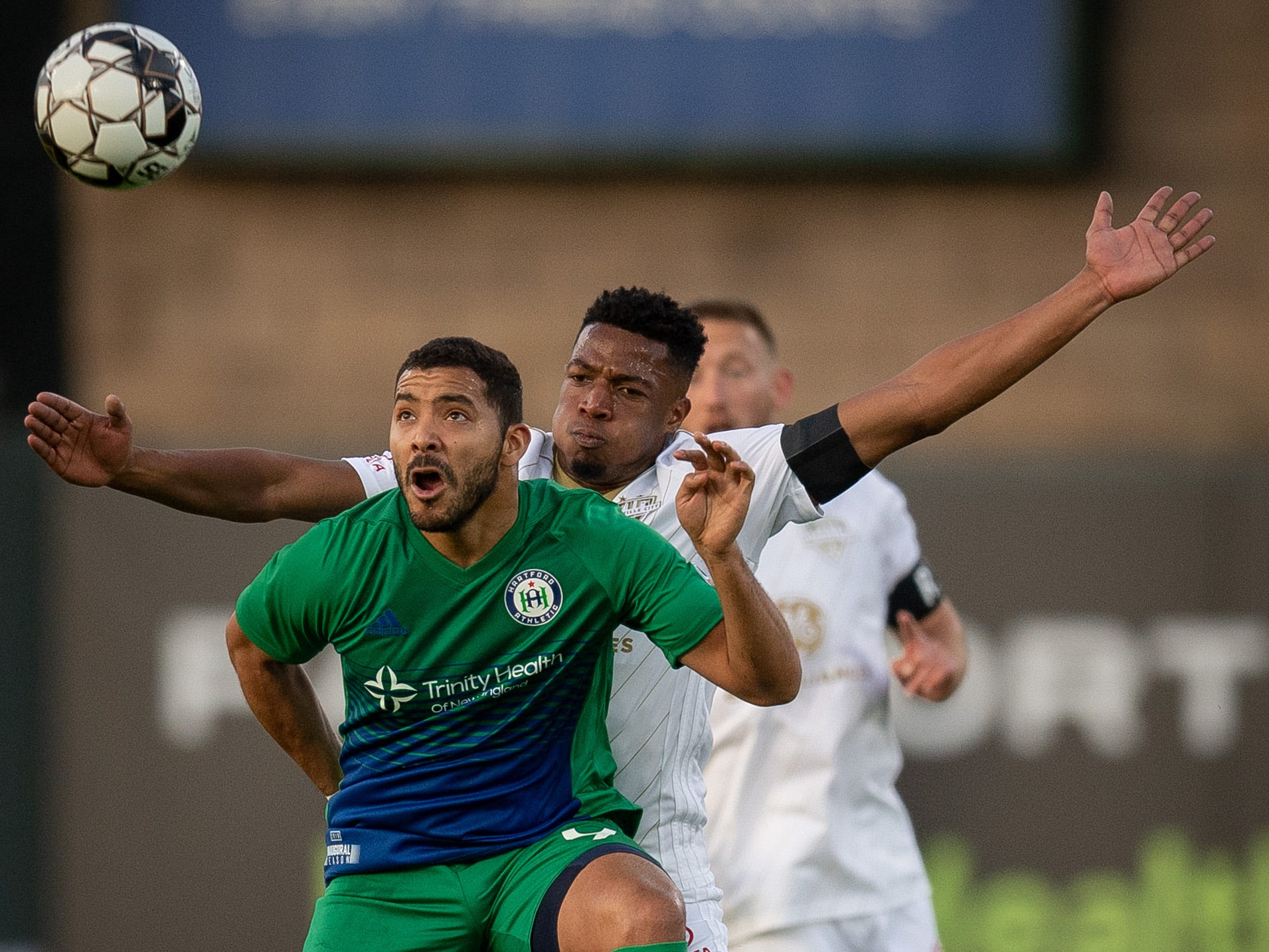 Louisville City FC defender Alexis Souahy (3) collides with Hartford Athletic Jose Angel (9) during the season opening match in Louisville, Ky., Saturday, March 23, 2019.