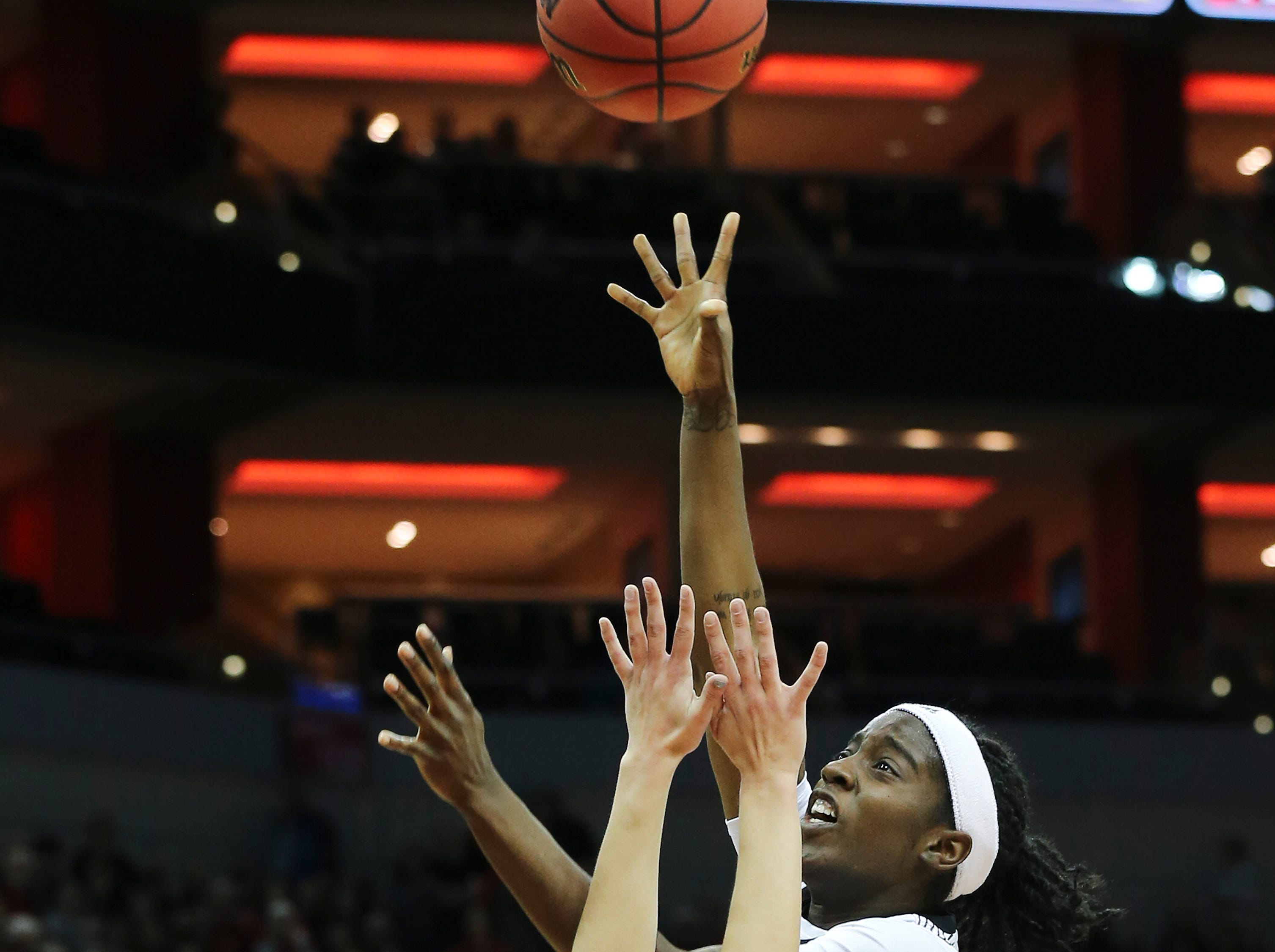 U of L's Jazmine Jones (23) shoots a hook shot against Michigan's Amy Dilk (1) during the second round of their NCAA Tournament game at the Yum Center.Mar. 24, 2019