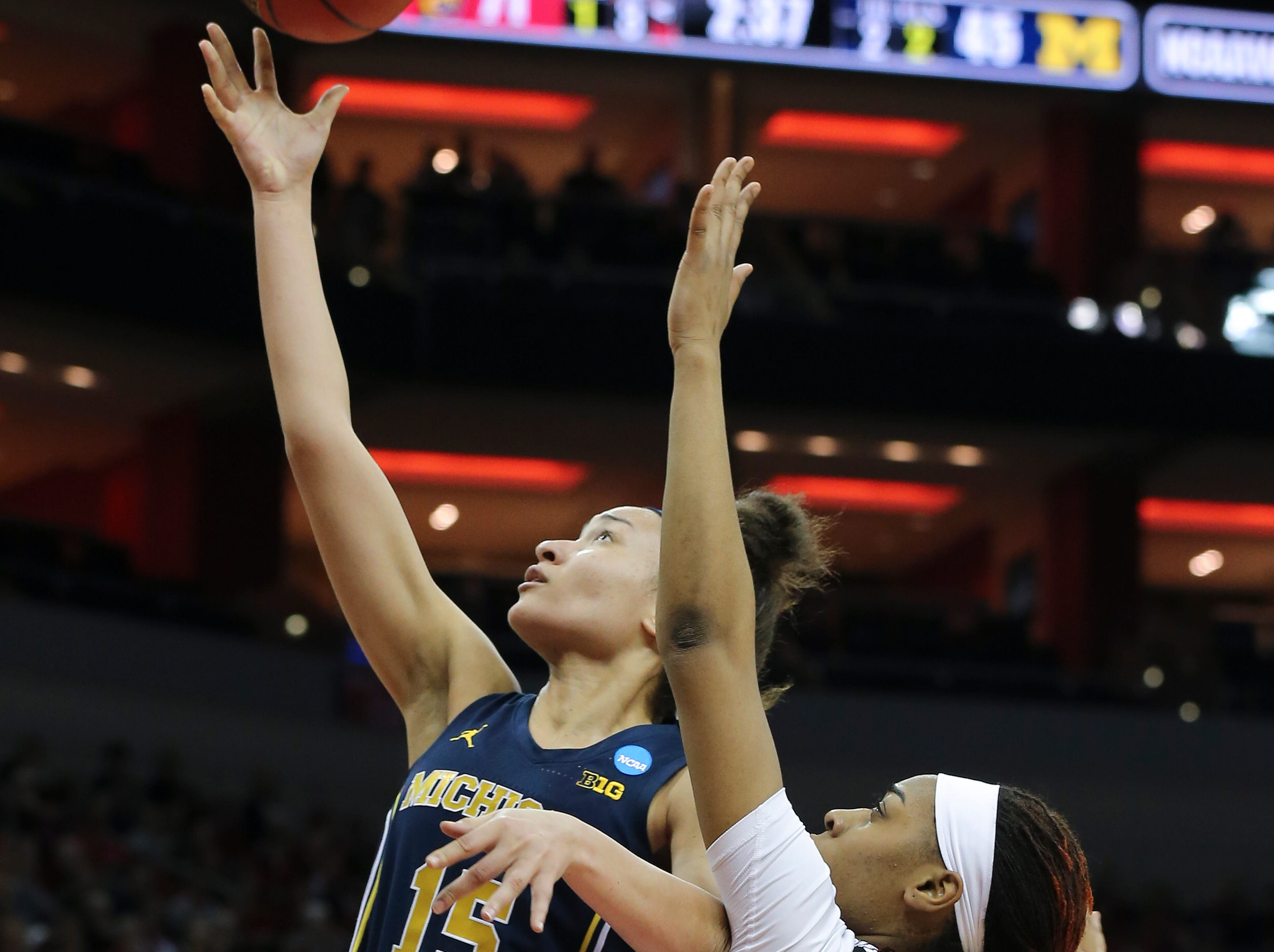 Michigan's Hailey Brown (15) shot against U of L's Bionca Dunham (33) during the second round of their NCAA Tournament game at the Yum Center.Mar. 24, 2019