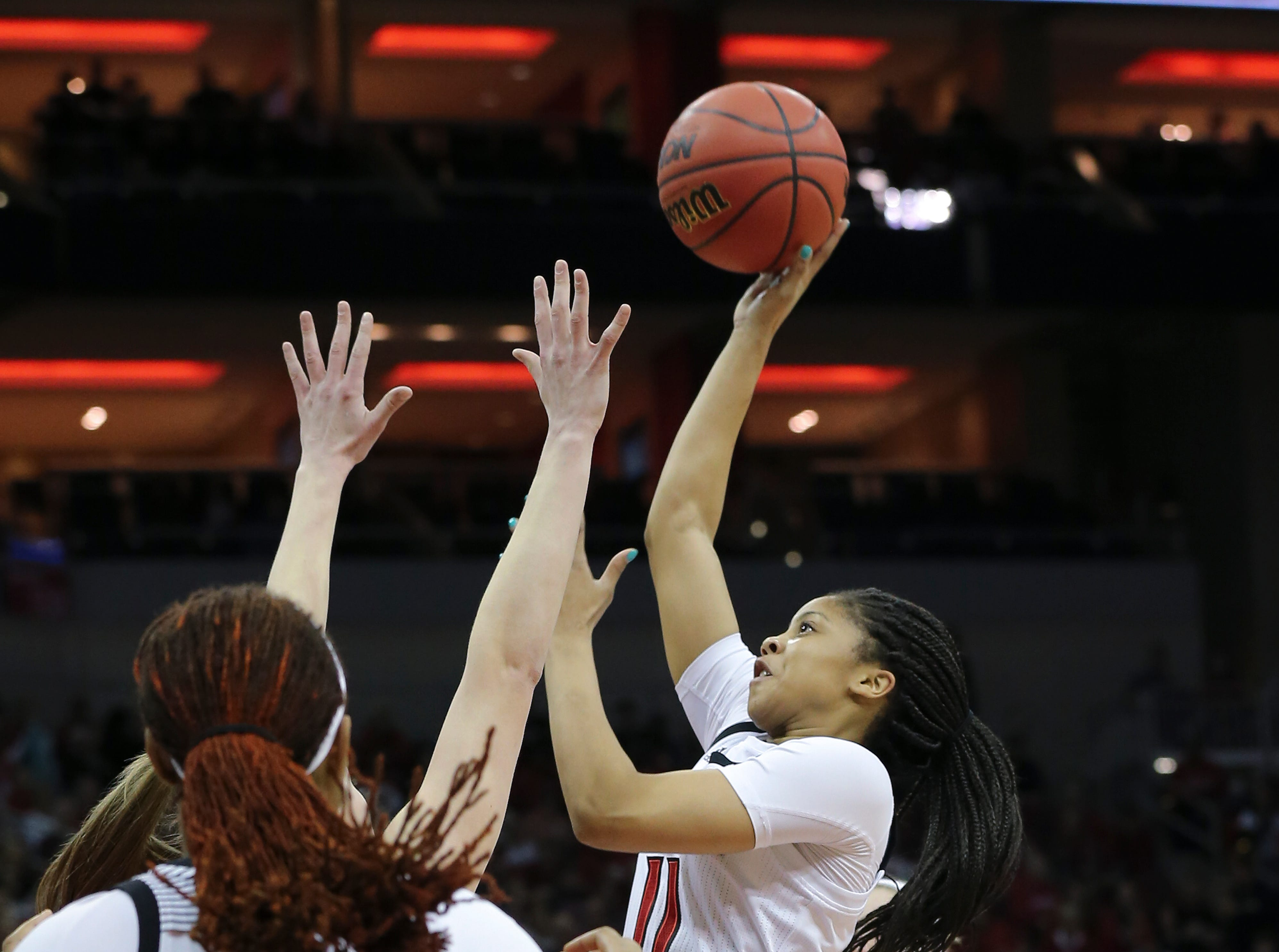 U of L's Arica Carter (11) shoots against Michigan in the second round of their NCAA Tournament game at the Yum Center.  Mar. 24, 2019