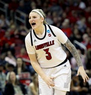 Louisville's Sam Fuehring shouts to her teammates during the game against Michigan at the KFC Yum Center on March 24.