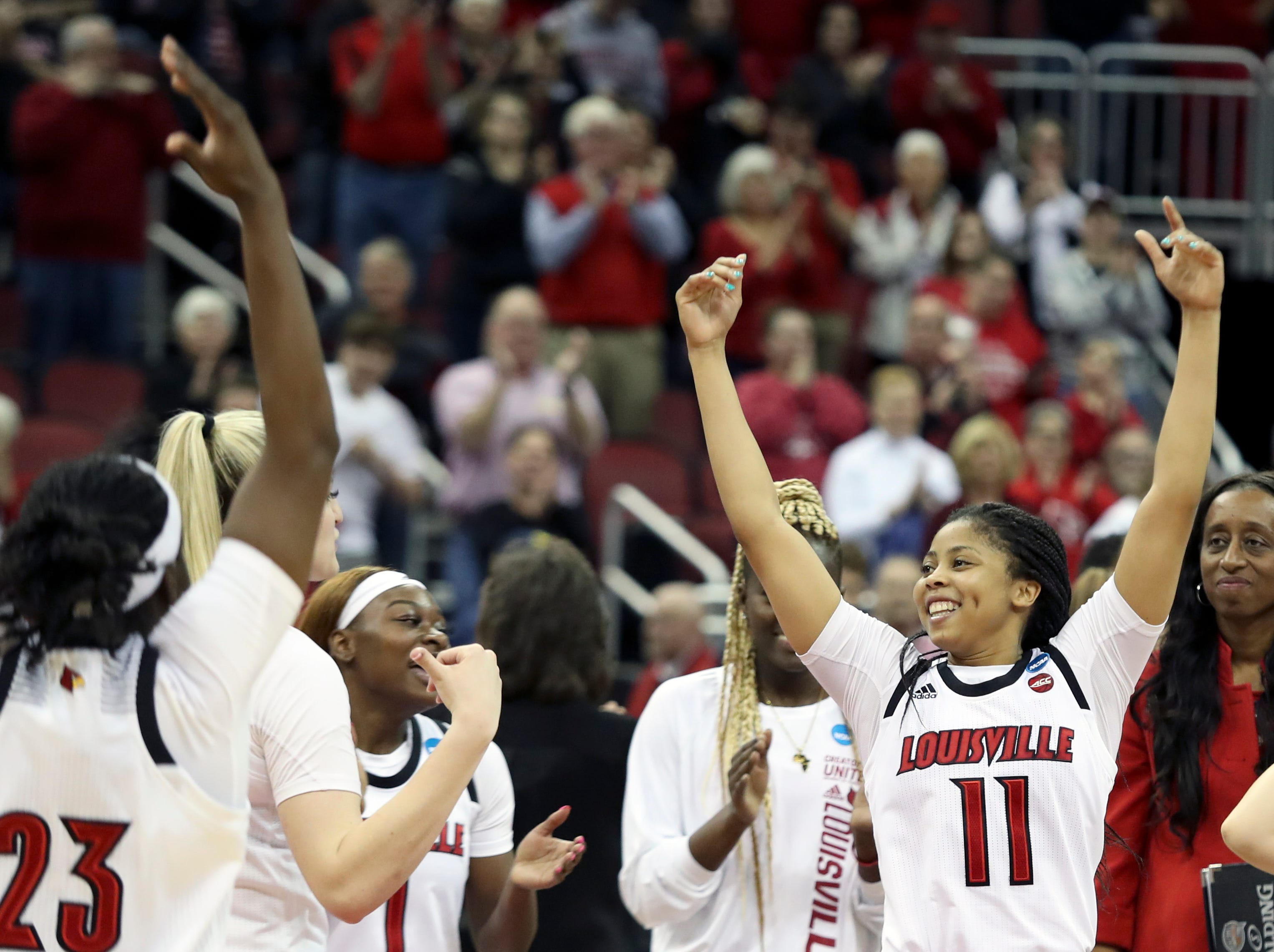Louisville's Arica Carter celebrates with her team after the Cardinals punch their ticket to the Sweet 16 by beating Michigan at the KFC Yum Center on March 24.