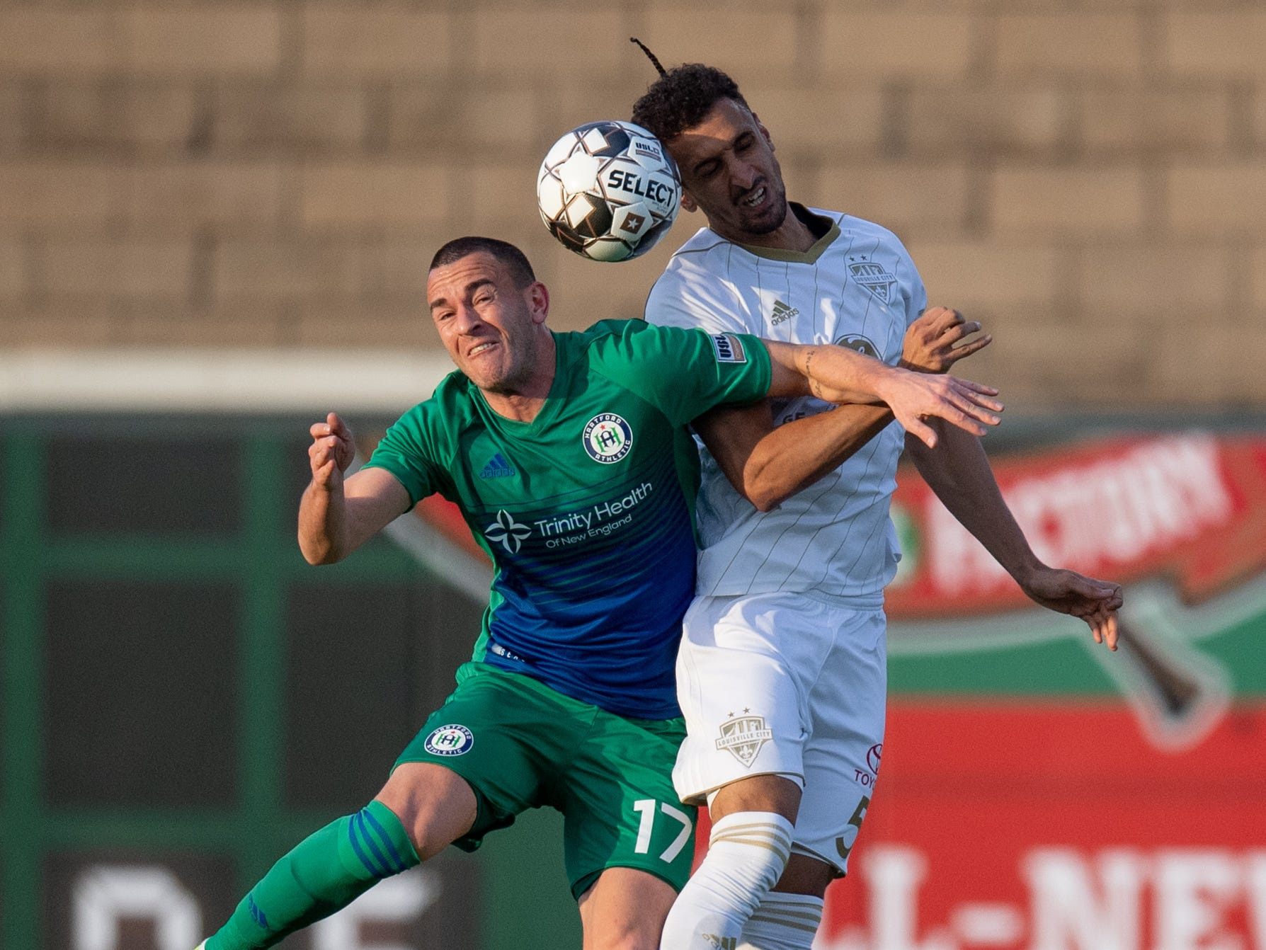 Louisville City FC defender Paco Craig (5) collides with Hartford Athletic Jonathan Broan (17) during the season opening match in Louisville, Ky., Saturday, March 23, 2019.