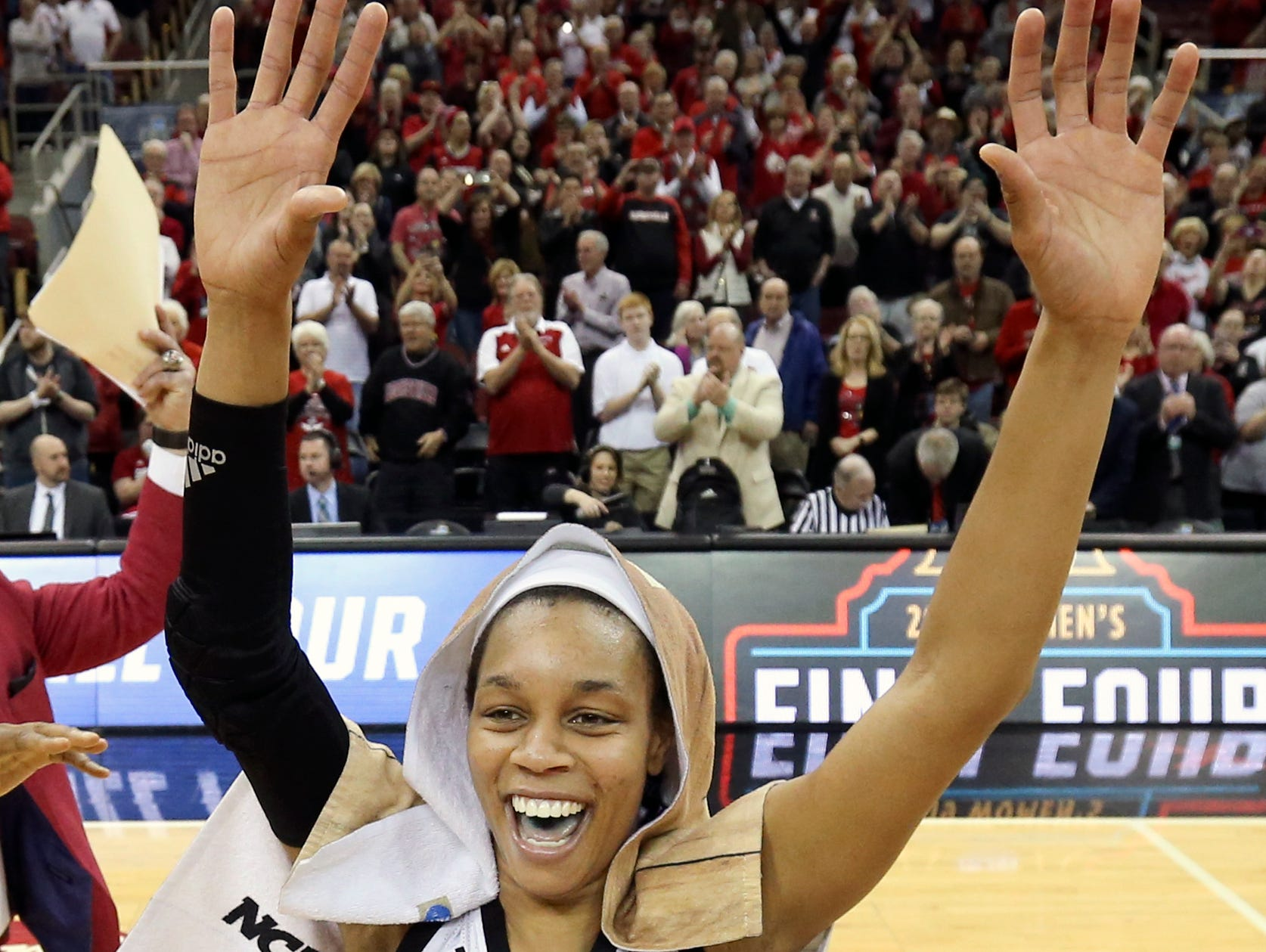 Louisville's Asia Durr celebrates after the Cardinals punch their ticket to the Sweet 16 by beating Michigan at the KFC Yum Center on March 24.