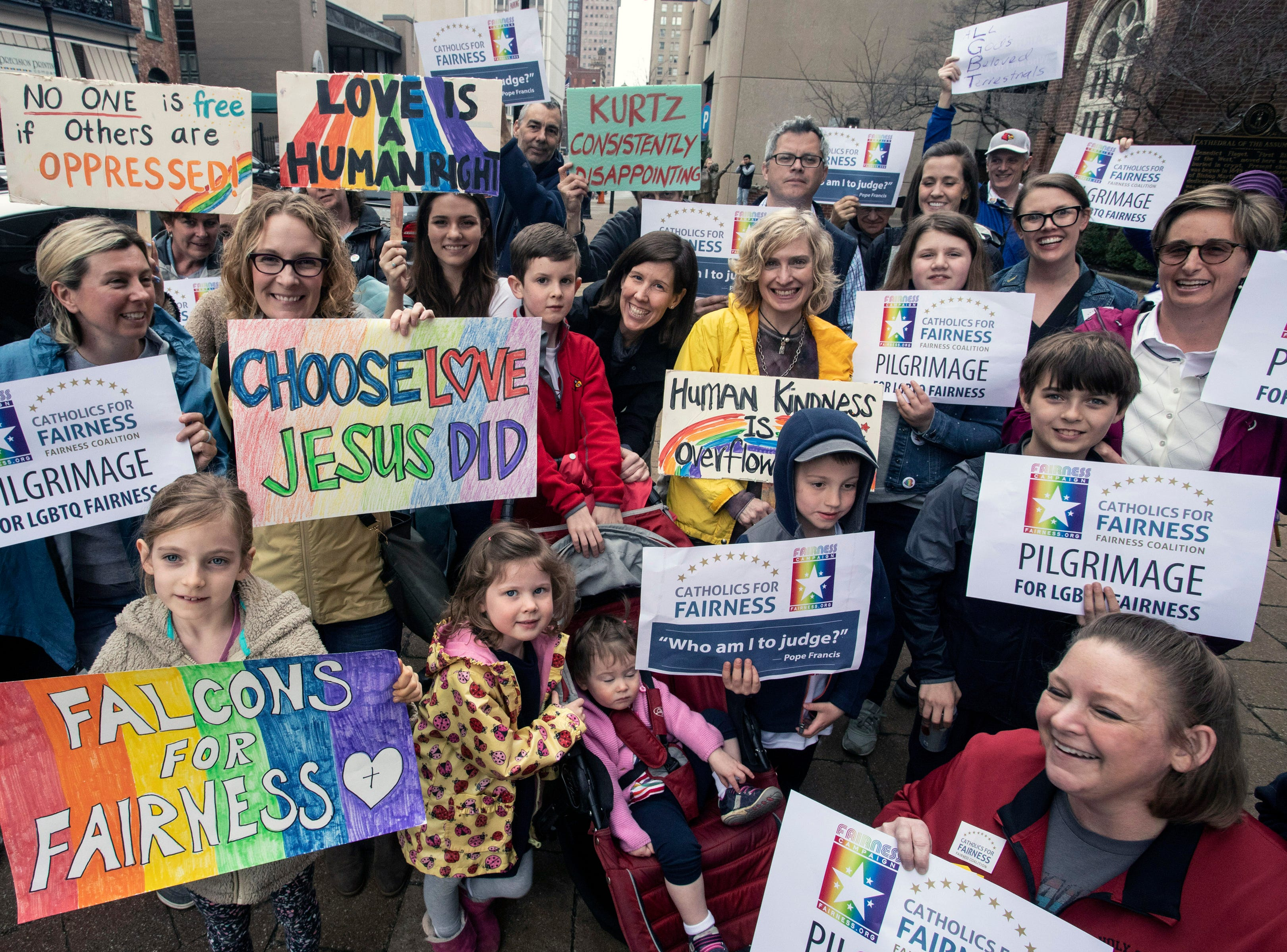 Signs of many colors were hoisted during the annual Catholics for Fairness Pilgrimage. March 24, 2019