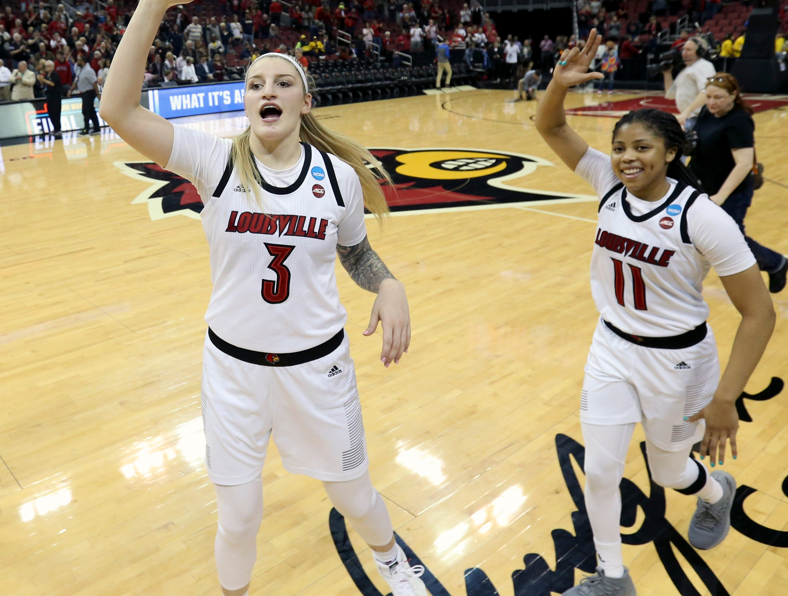 Louisville's Sam Fuehring , left, and Arica Carter do a celebration lap after the Cardinals punch their ticket to the Sweet 16 by beating Michigan at the KFC Yum Center on March 24.
