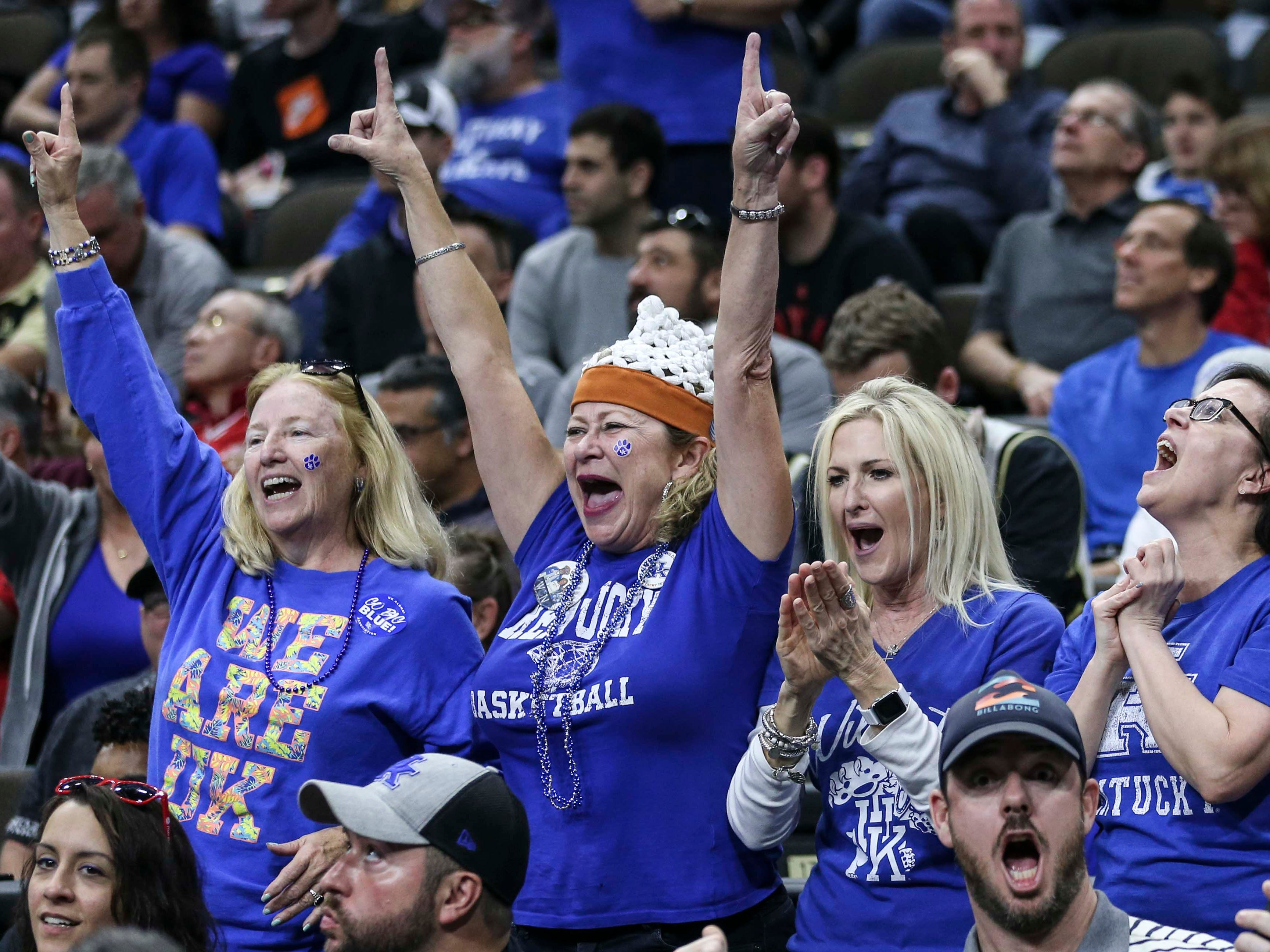 Kentucky fans cheer as the Wildcats beat a tenacious Wofford 62-56 in the second round game of the 2019 NCAA tournament in Jacksonville, Fla. March 23, 2019.