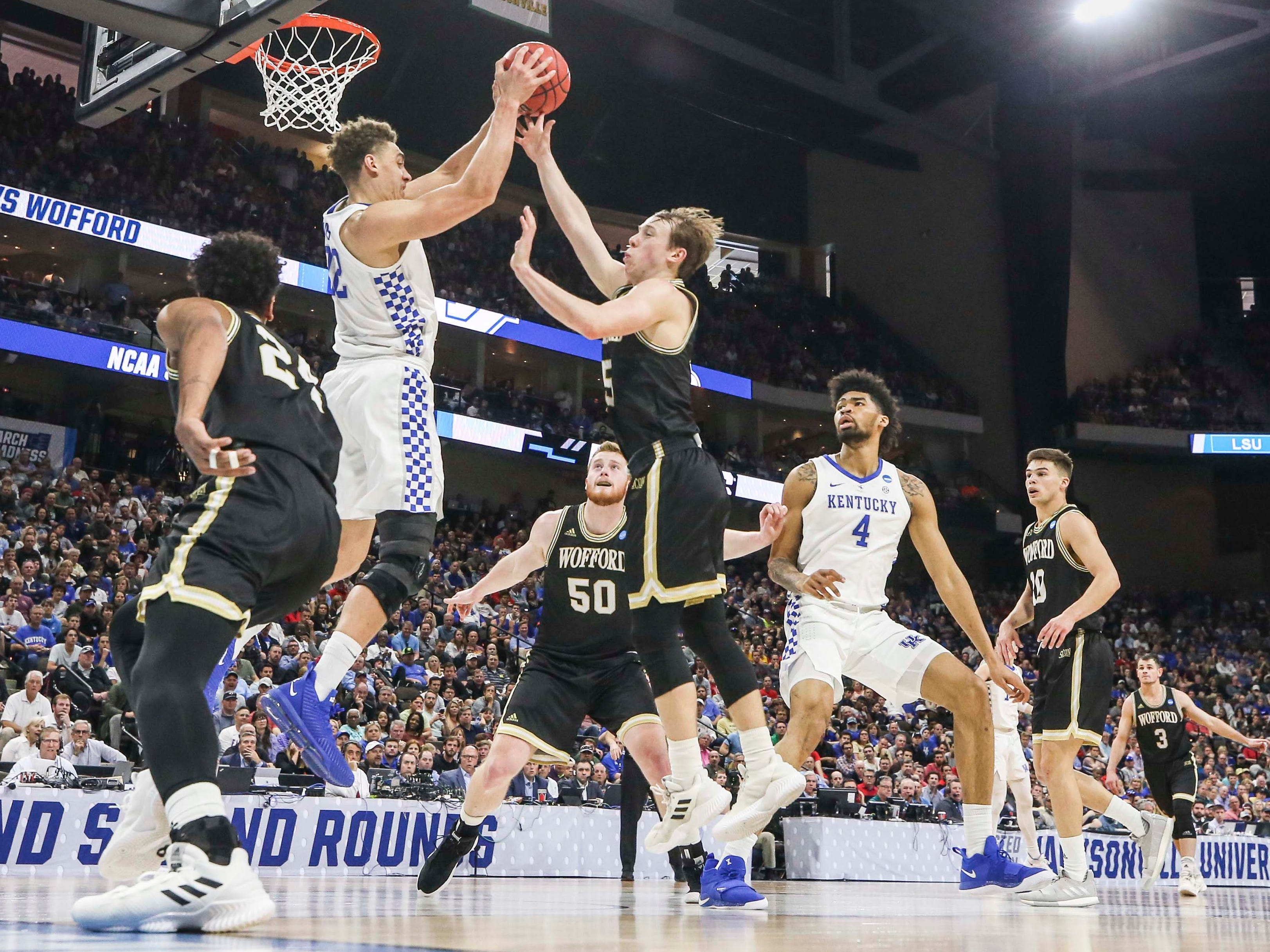 Kentucky's Reid Travis had 11 rebounds in the Wildcats' 62-56 win in the second round game of the 2019 NCAA tournament in Jacksonville, Fla. March 23, 2019