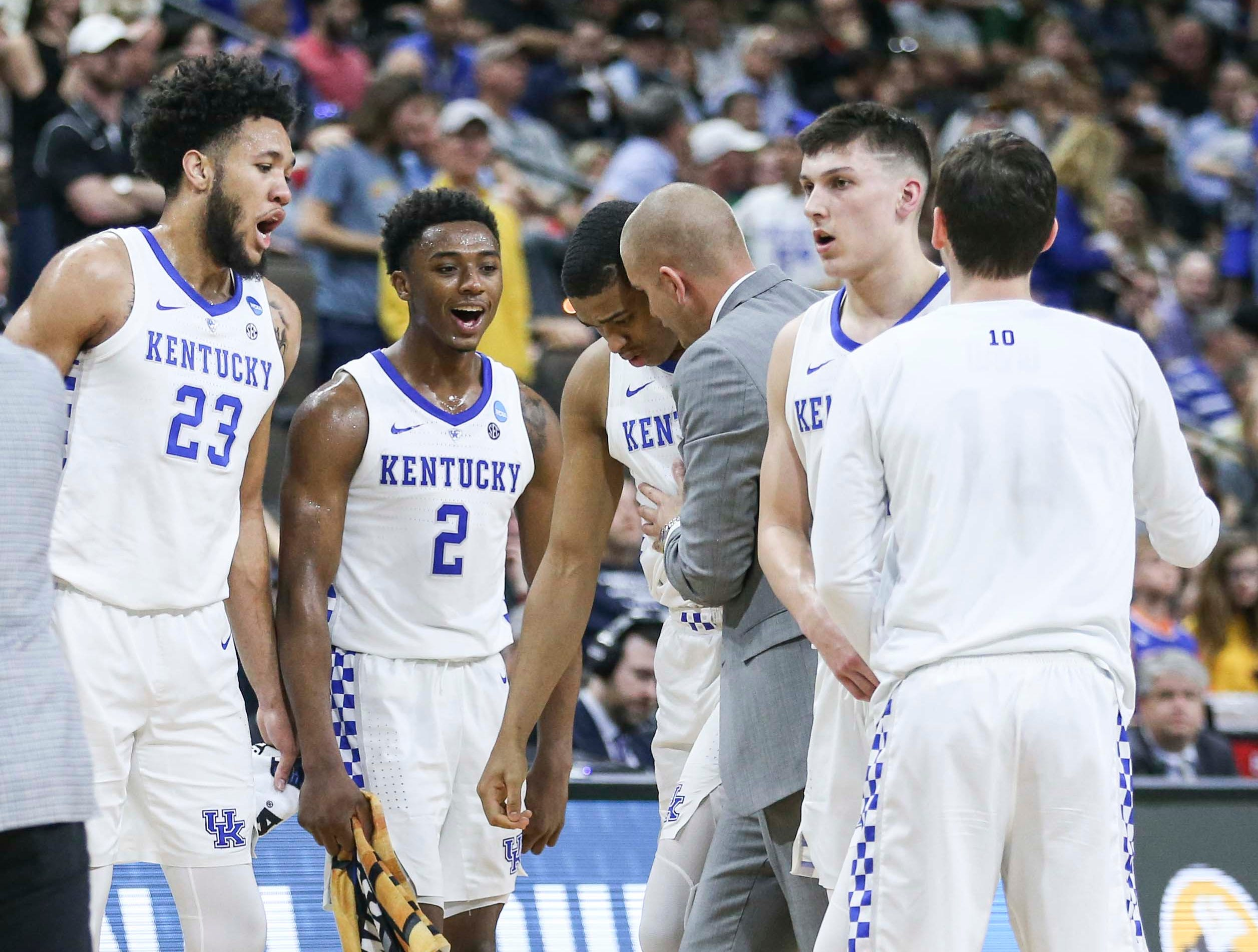 Kentucky's Keldon Johnson was surrounded by teammates during a time out in the Wildcats' 62-56 win in the second round game of the 2019 NCAA tournament in Jacksonville, Fla. March 23, 2019