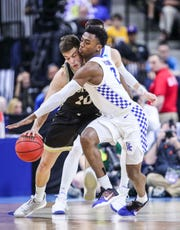 Kentucky's Ashton Hagans pressures WoffordNathan Hoover in the Wildcats' 62-56 win in the second round game of the 2019 NCAA tournament in Jacksonville, Fla. March 23, 2019