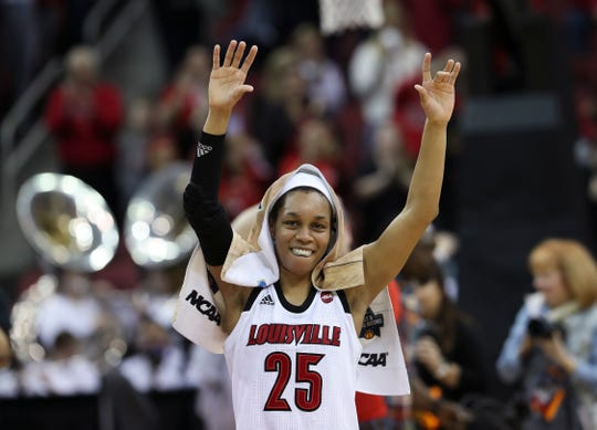 U of L's Asia Durr (25) acknowledges the crowd after their 71-50 defeat of Michigan in the second round of their NCAA Tournament game at the Yum Center.  They advance to the Sweet 16 in the Albany regional. Mar. 24, 2019.