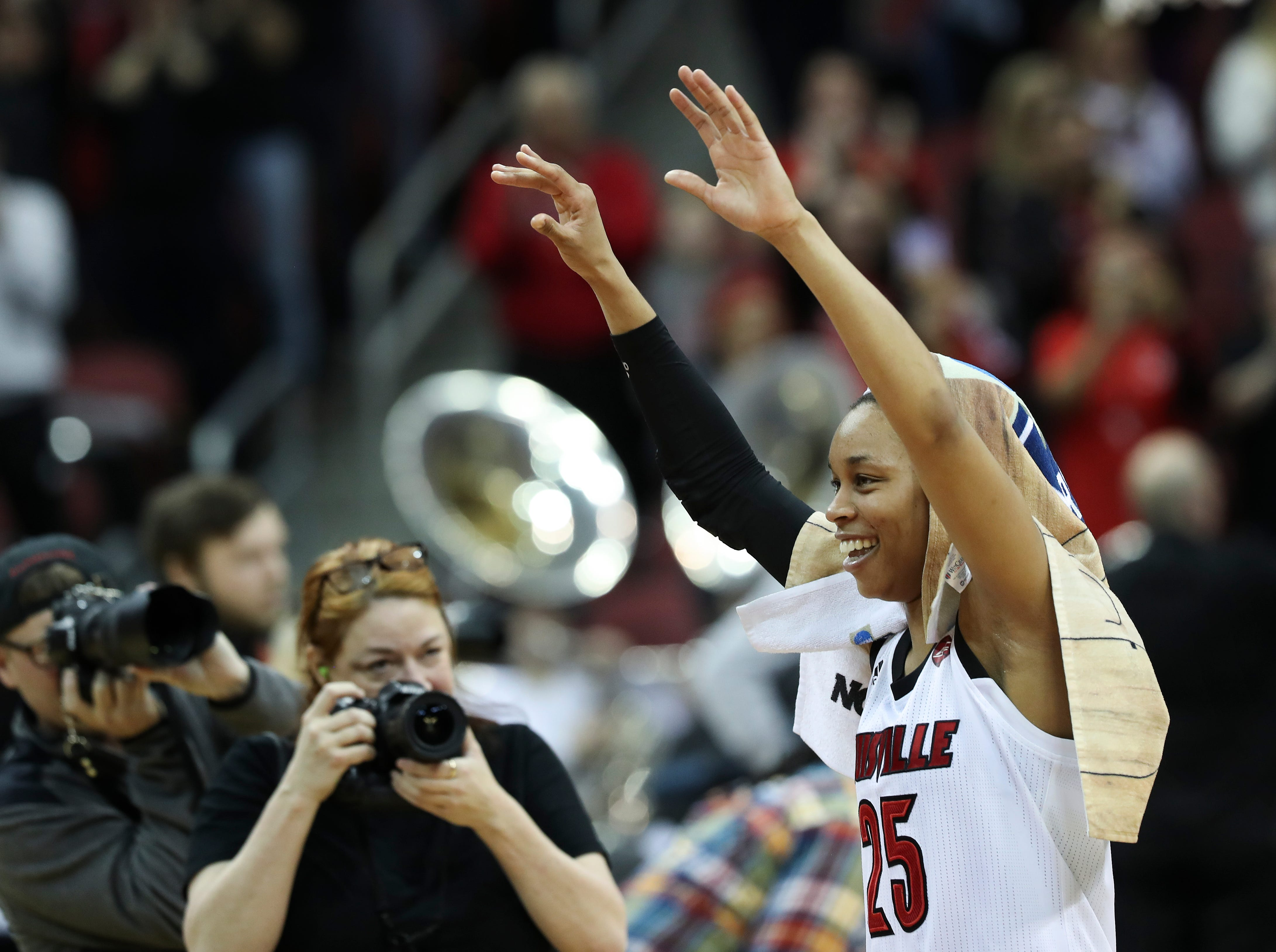 U of L's Asia Durr (25) acknowledges the crowd after their 71-50 defeat of Michigan in the second round of their NCAA Tournament game at the Yum Center.  They advance to the Sweet 16 in the Albany regional.Mar. 24, 2019